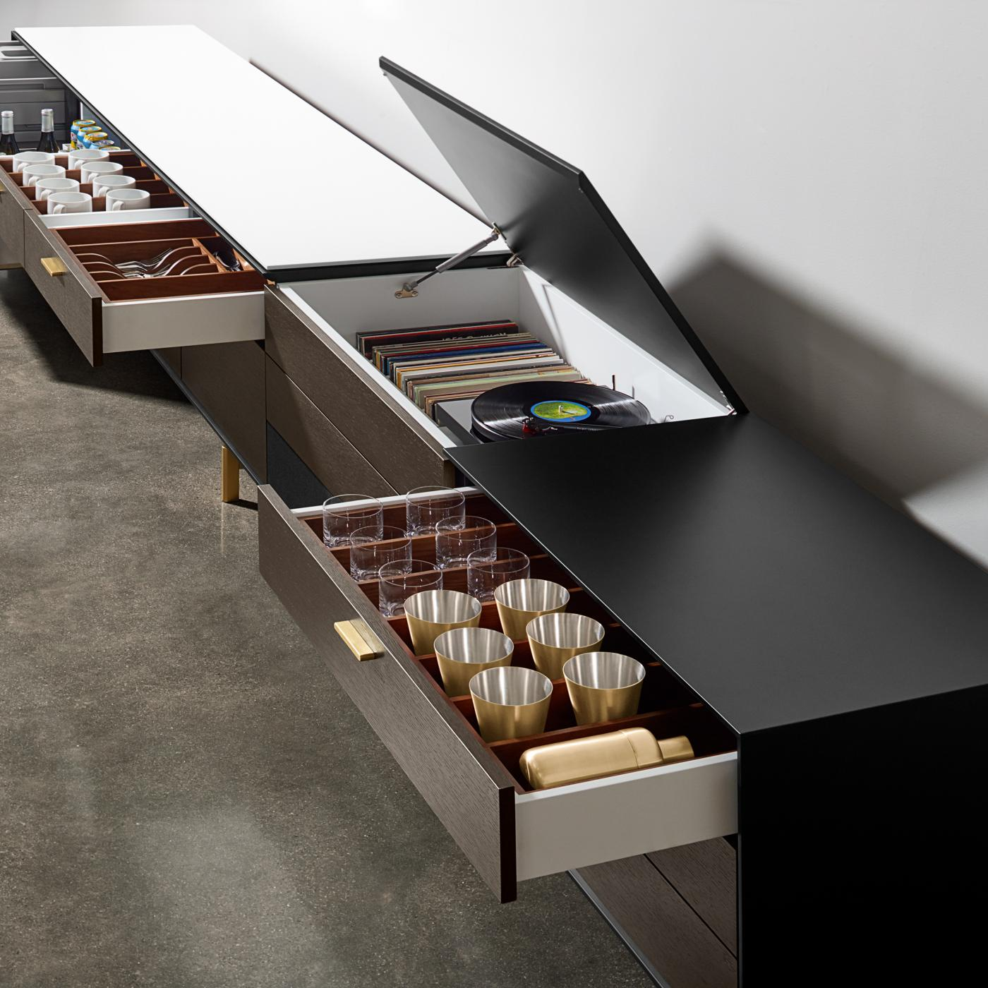 Glassware, refrigeration, entertainment, food service and cleanup are some of the innovative elements of a Halo sideboard.