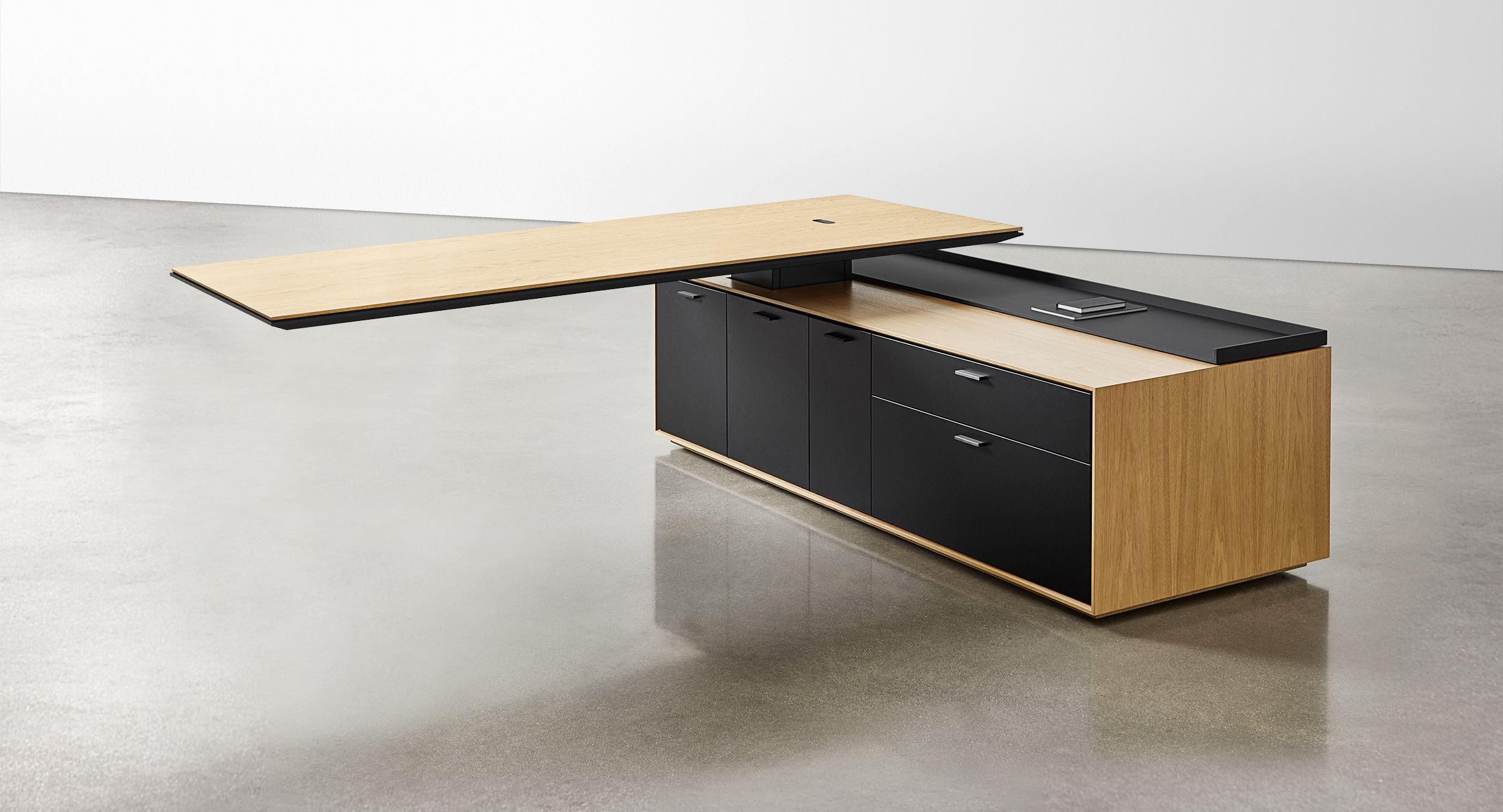 Defy gravity with an adjustable-height, cantilevered desk surface.