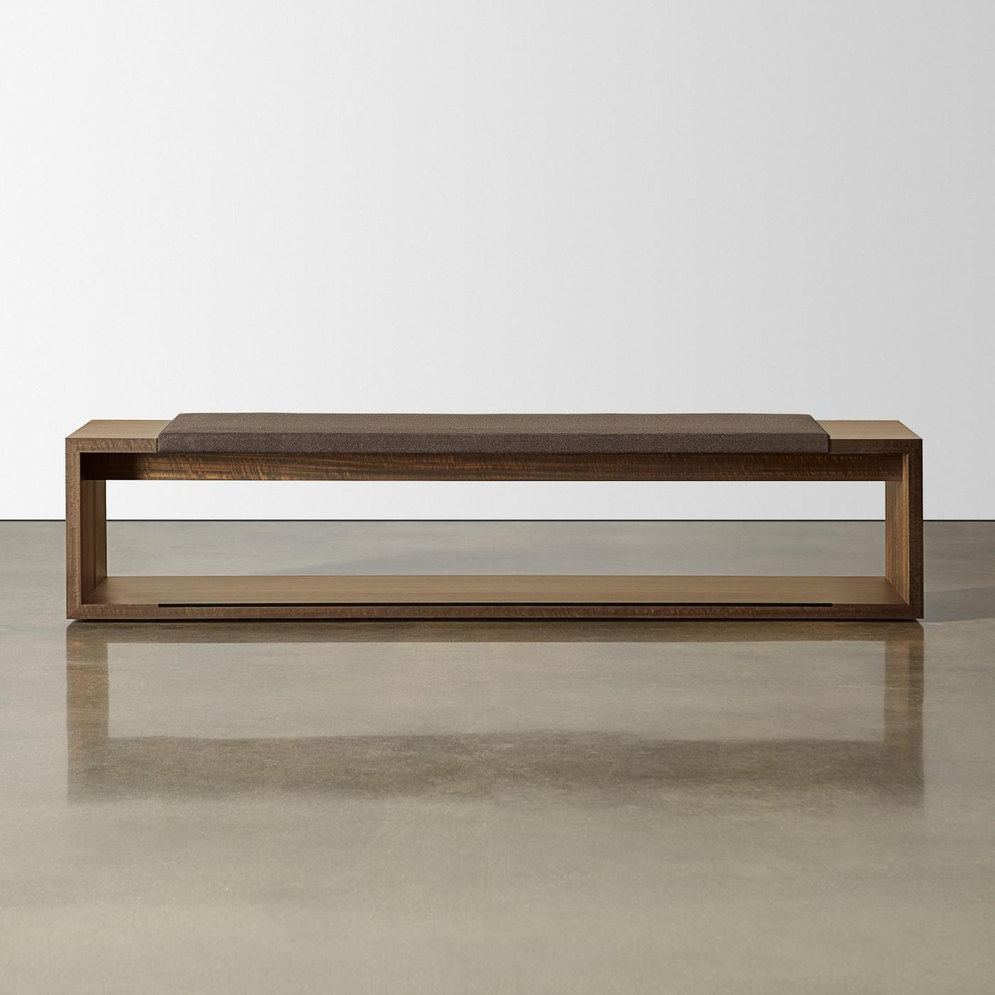 Each bench includes a gracious seating cushion and convenient table surfaces at each end of the bench.
