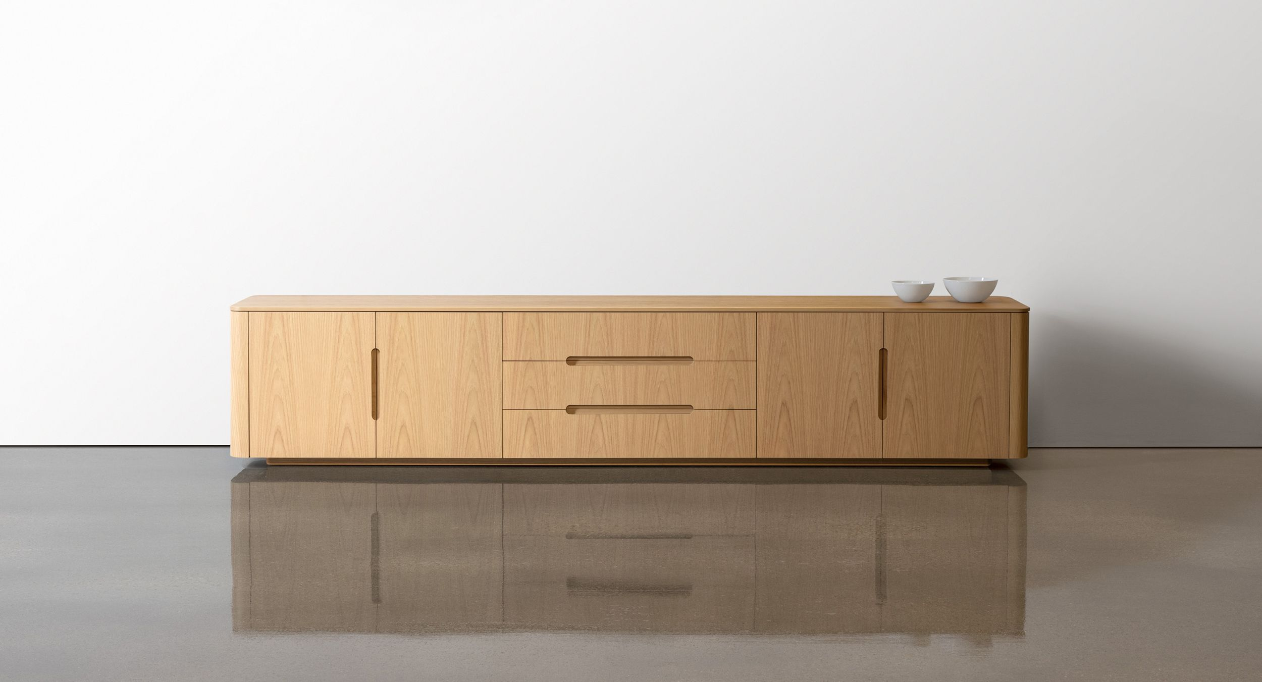 CREW sideboards are a complete storage solution with graceful curves to soften your modern meeting space.