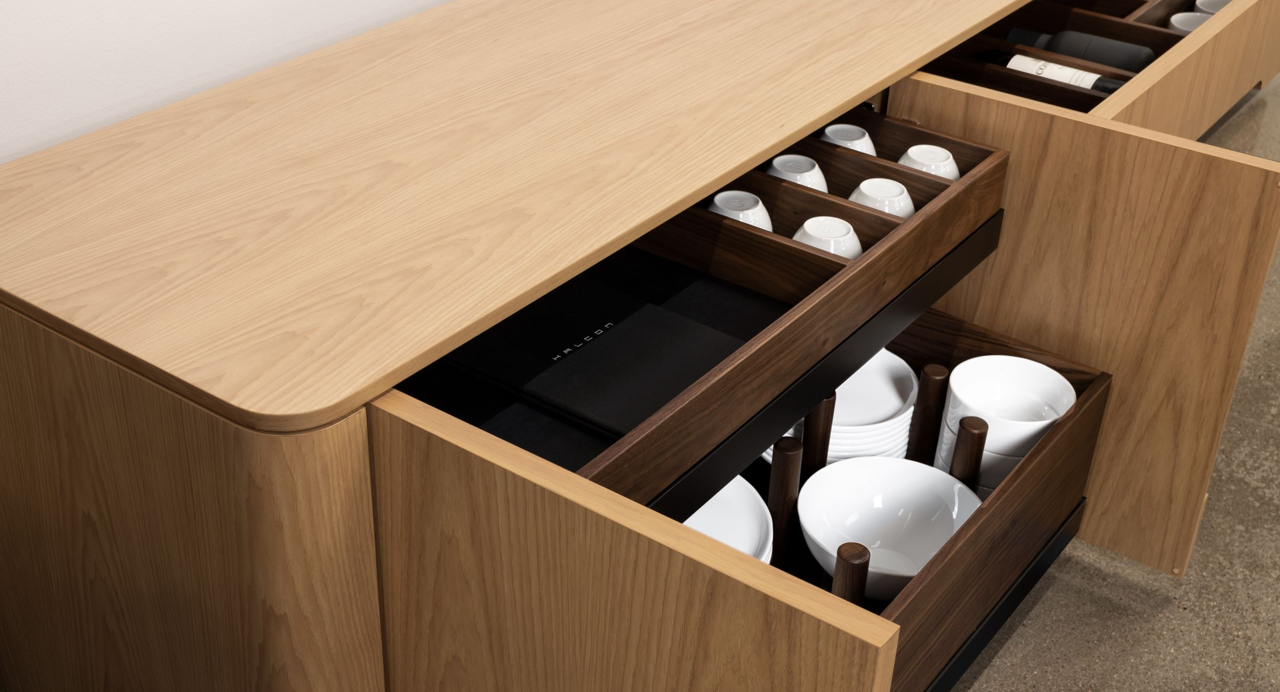 Thoughtful modules accommodate glassware, cutlery, refrigeration, and more.  Solid wood storage trays are easily removed for fast and convenient service.