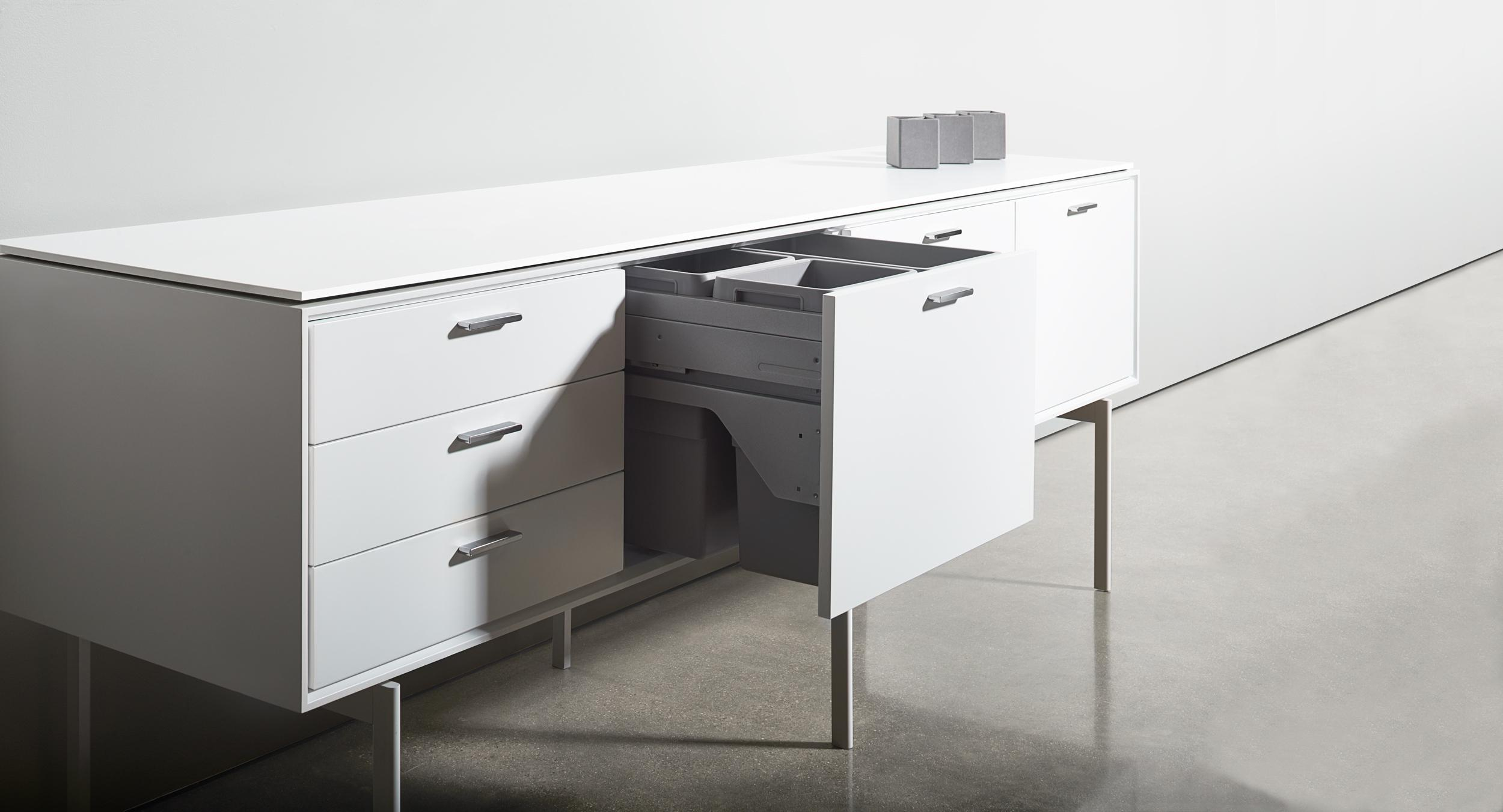 Halo offers a complete range of storage elements including a voluminous triple waste bin in a compact, 24-inch wide module.