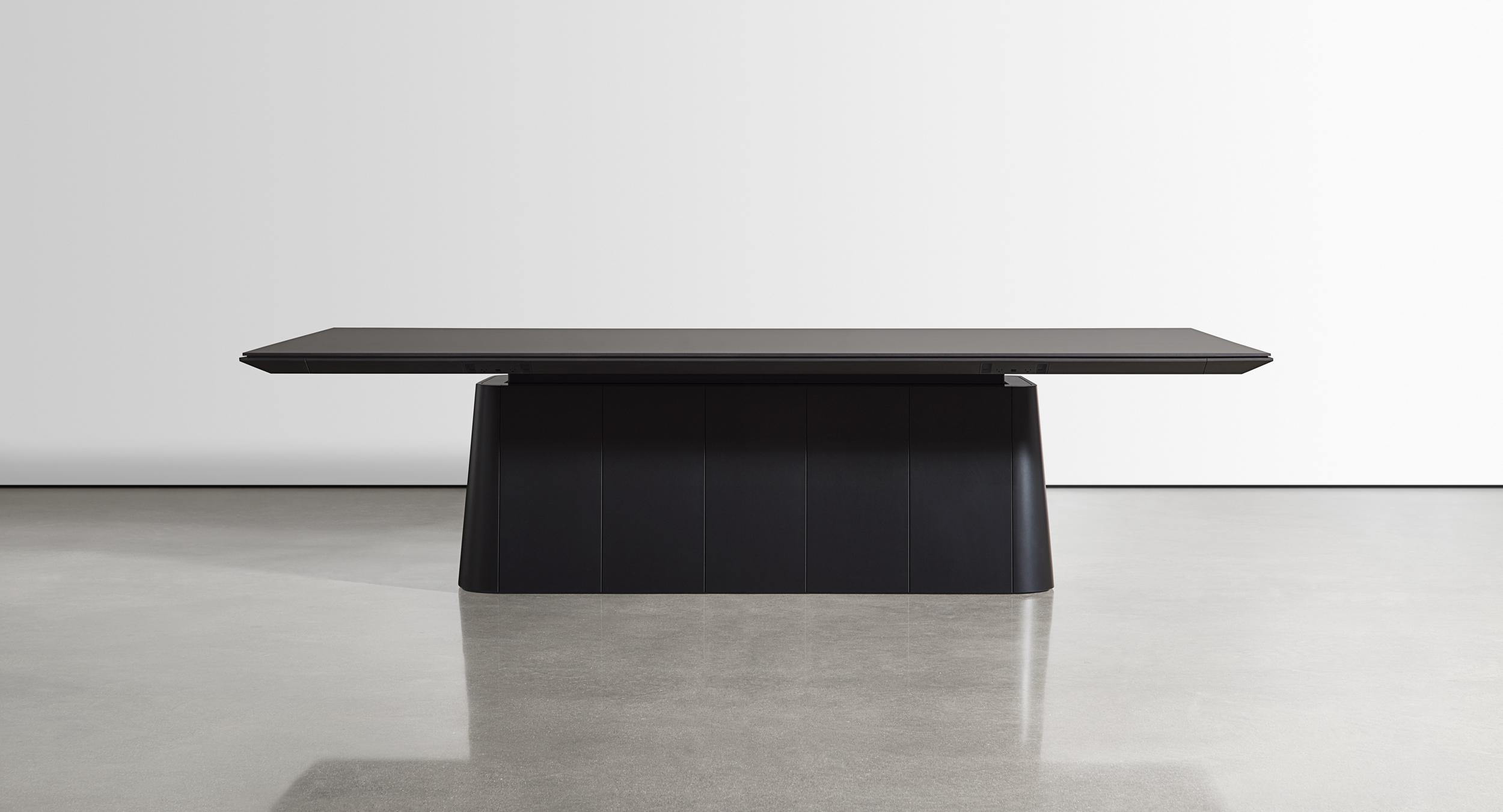The Halo collection includes award-winning adjustable-height meeting tables.
