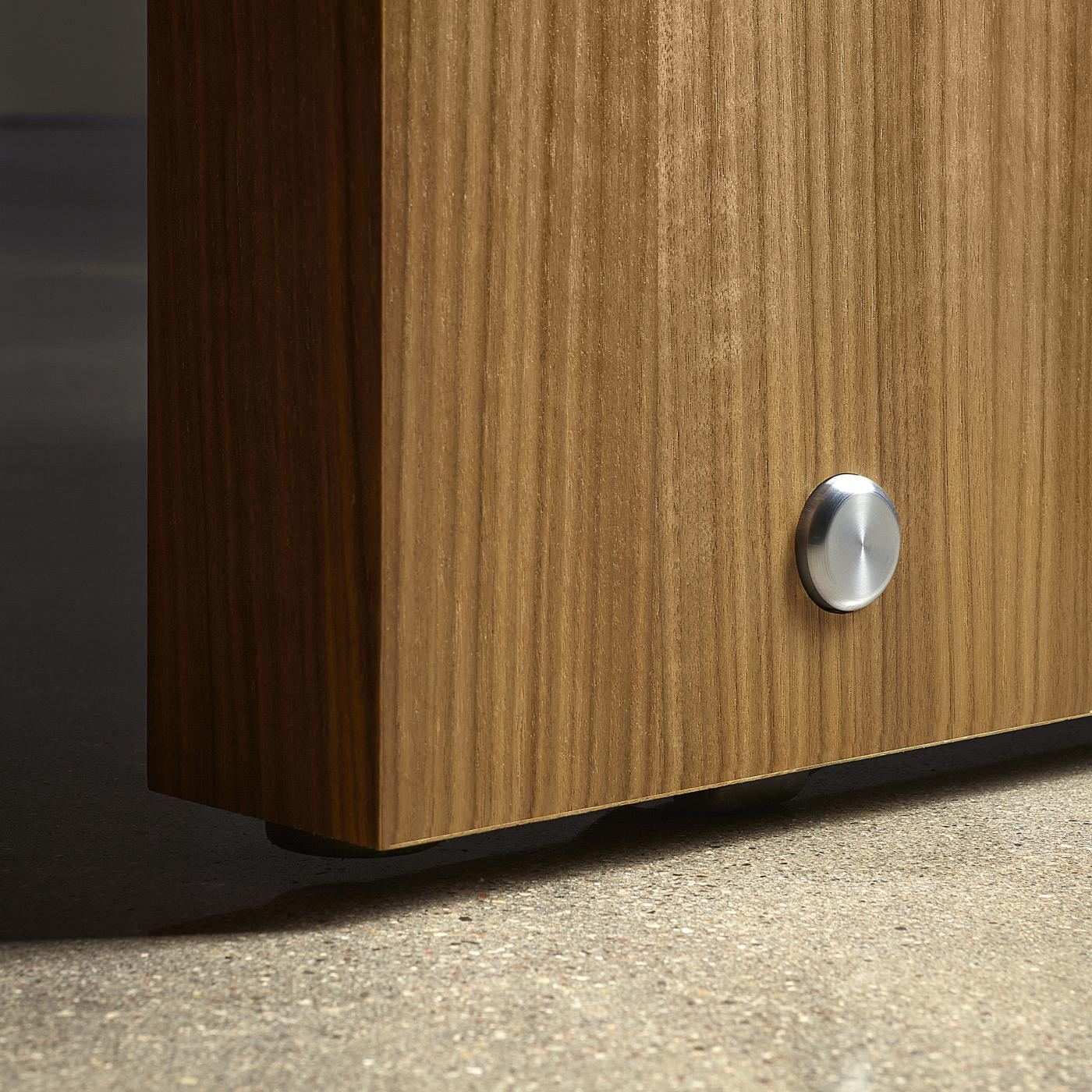 Stainless steel pins subtly express innovative, integral casters.