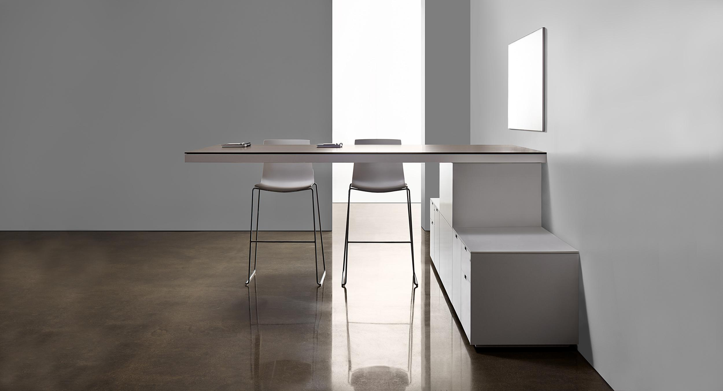 Defy gravity with a free-floating, cantilevered standing-height table.
