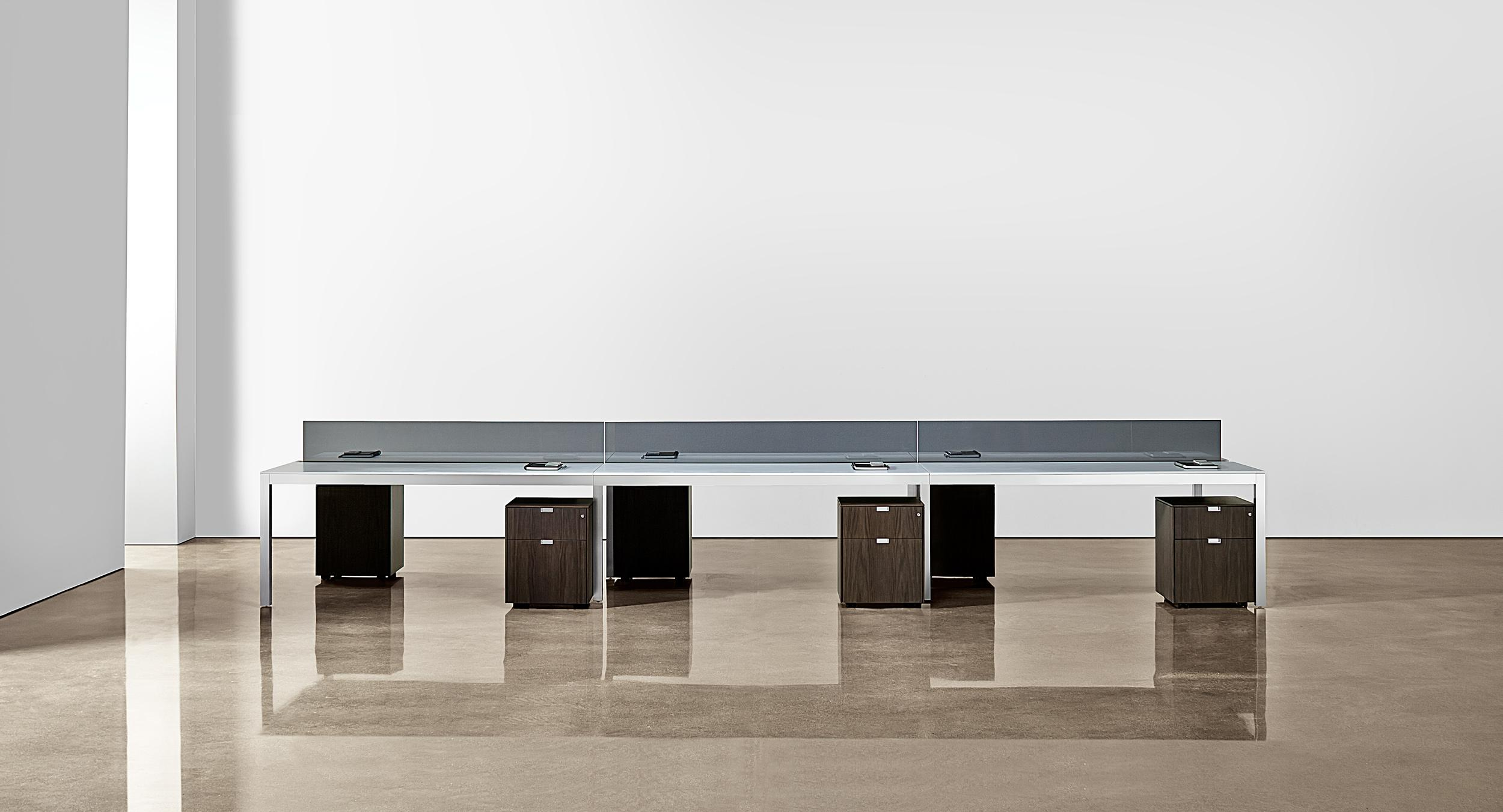 Sliding worksurfaces and a centerline technology beam achieve the ultimate in functional minimalism while preserving flexibility and scalability.