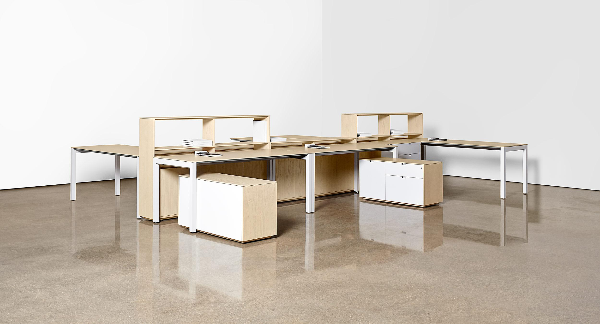 Form and re-form groups and teams with freestanding desks and storage along a centerline spine wall.