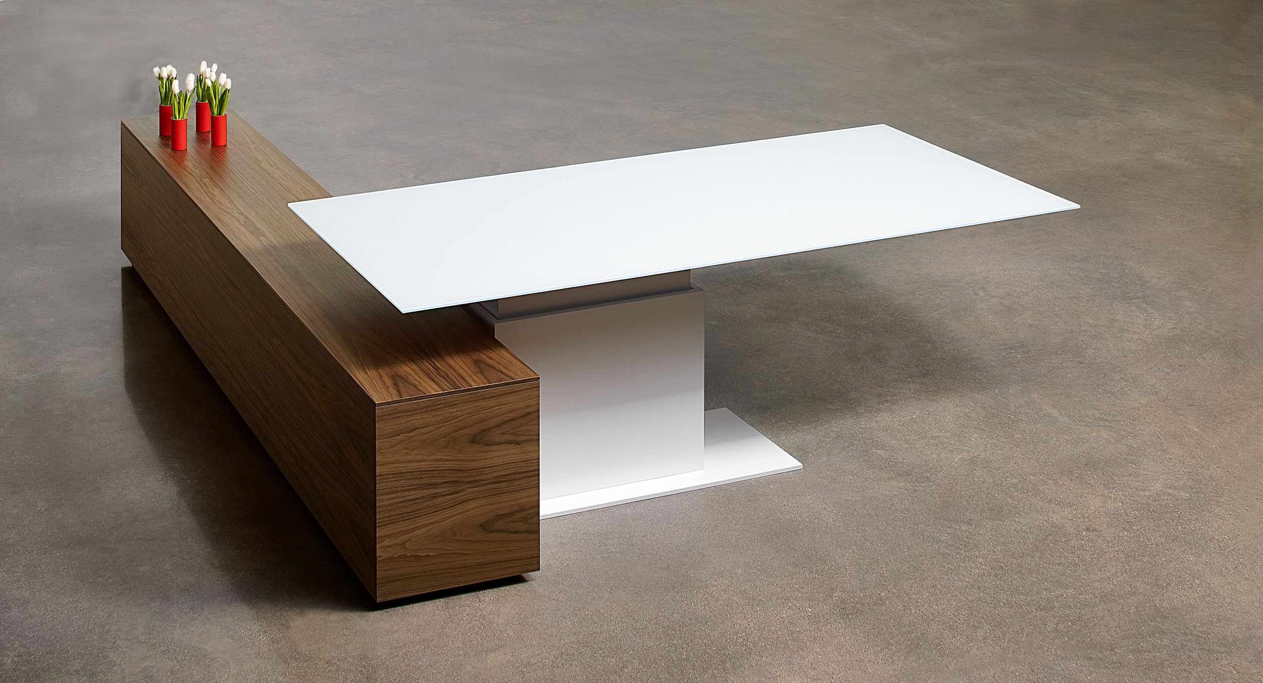 This adjustable-height desk features a beautifully-cantilevered surface.