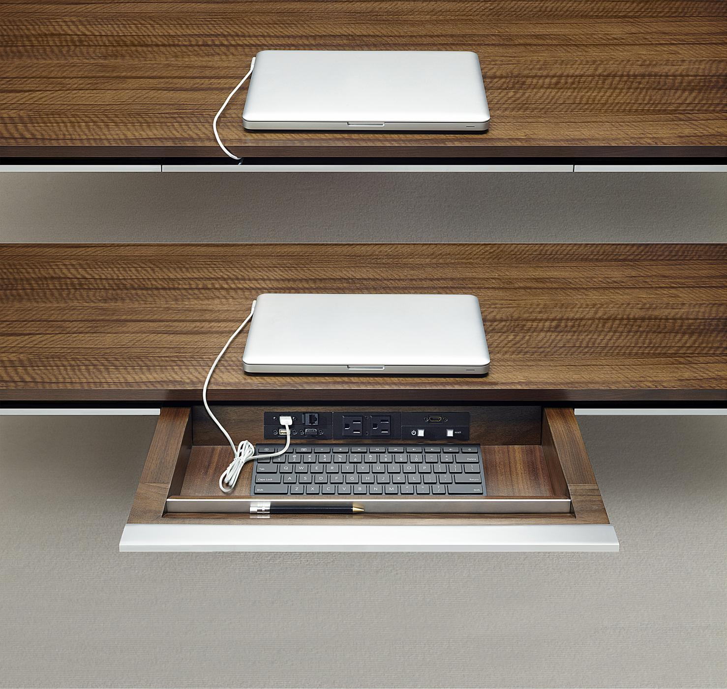 Comfortably access technology with Mesa's innovative, concealed drawers.