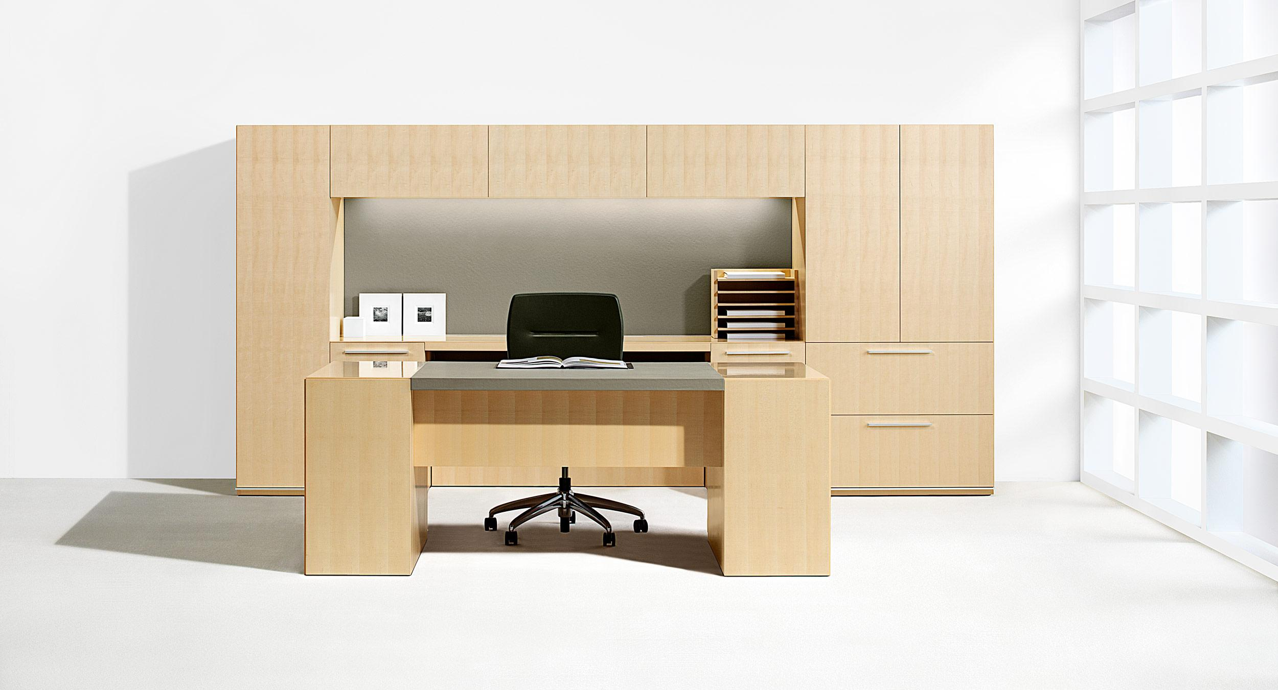 Freestanding desks pair perfectly with minimalist Mitre workwalls.