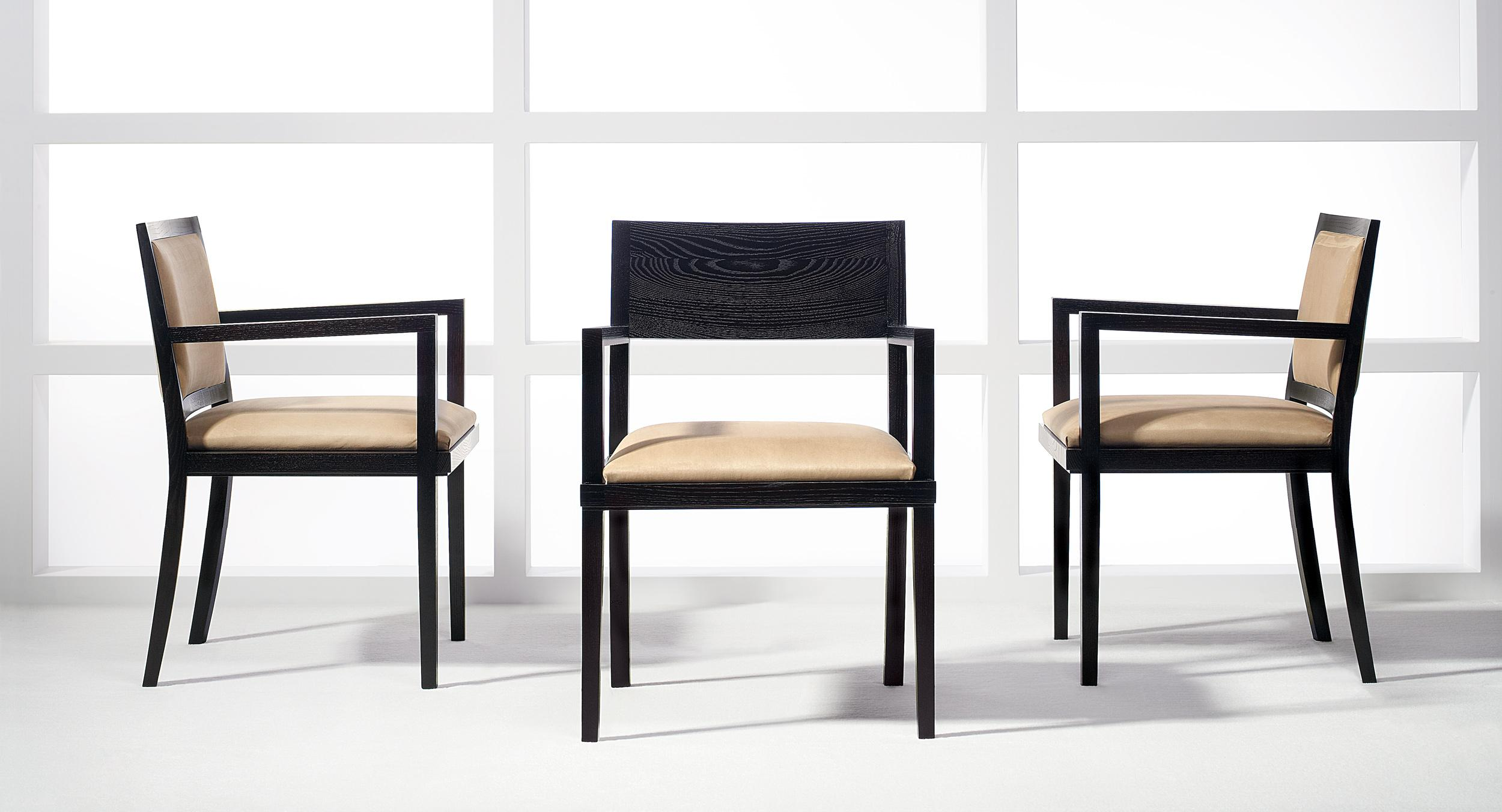 Mitre guest seating is available with a fabric back or partial height solid horizontal wood back.