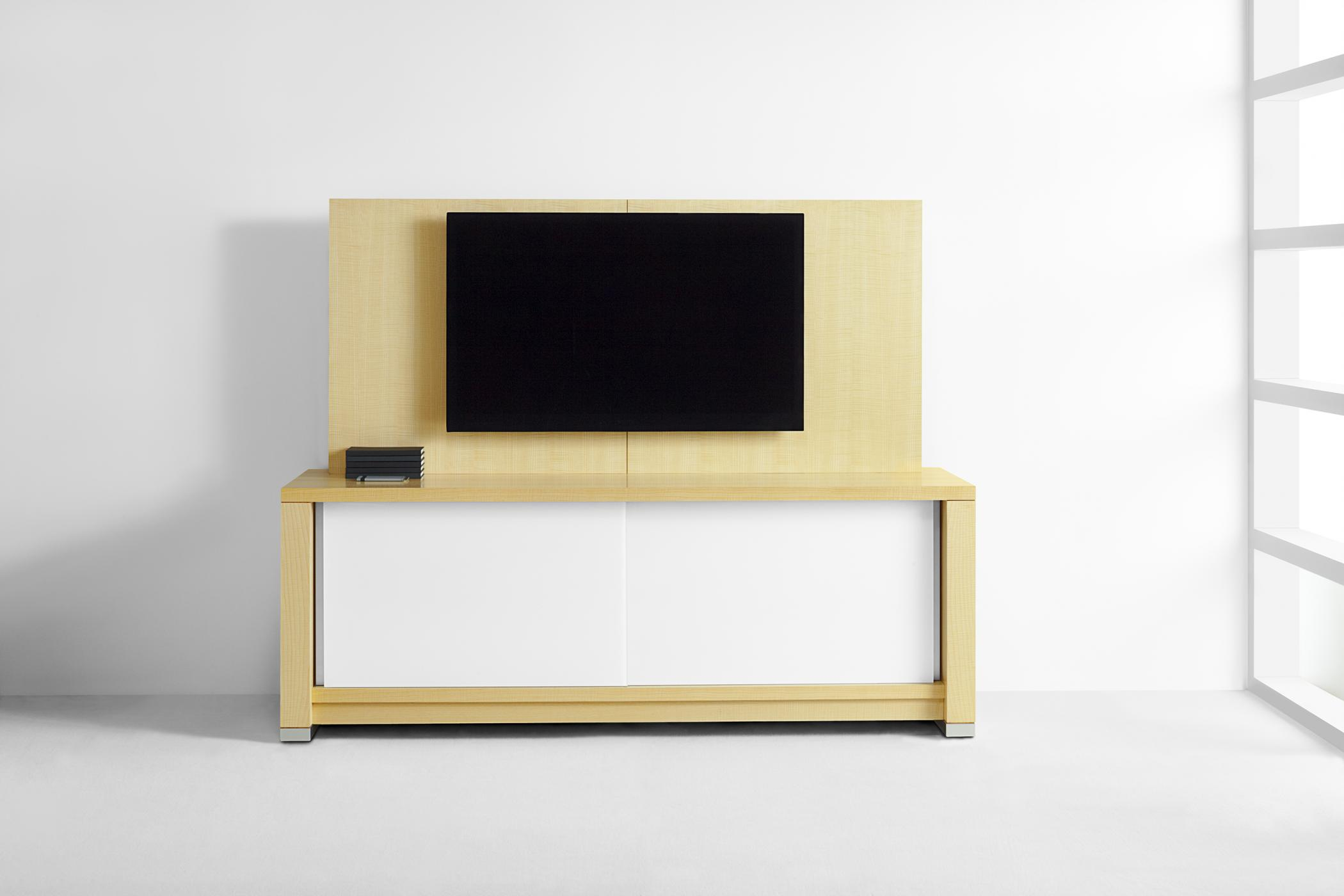 The Motus Media Credenza features concealed casters, sliding doors for A/V storage, and integrated pathways for TV connectivity.