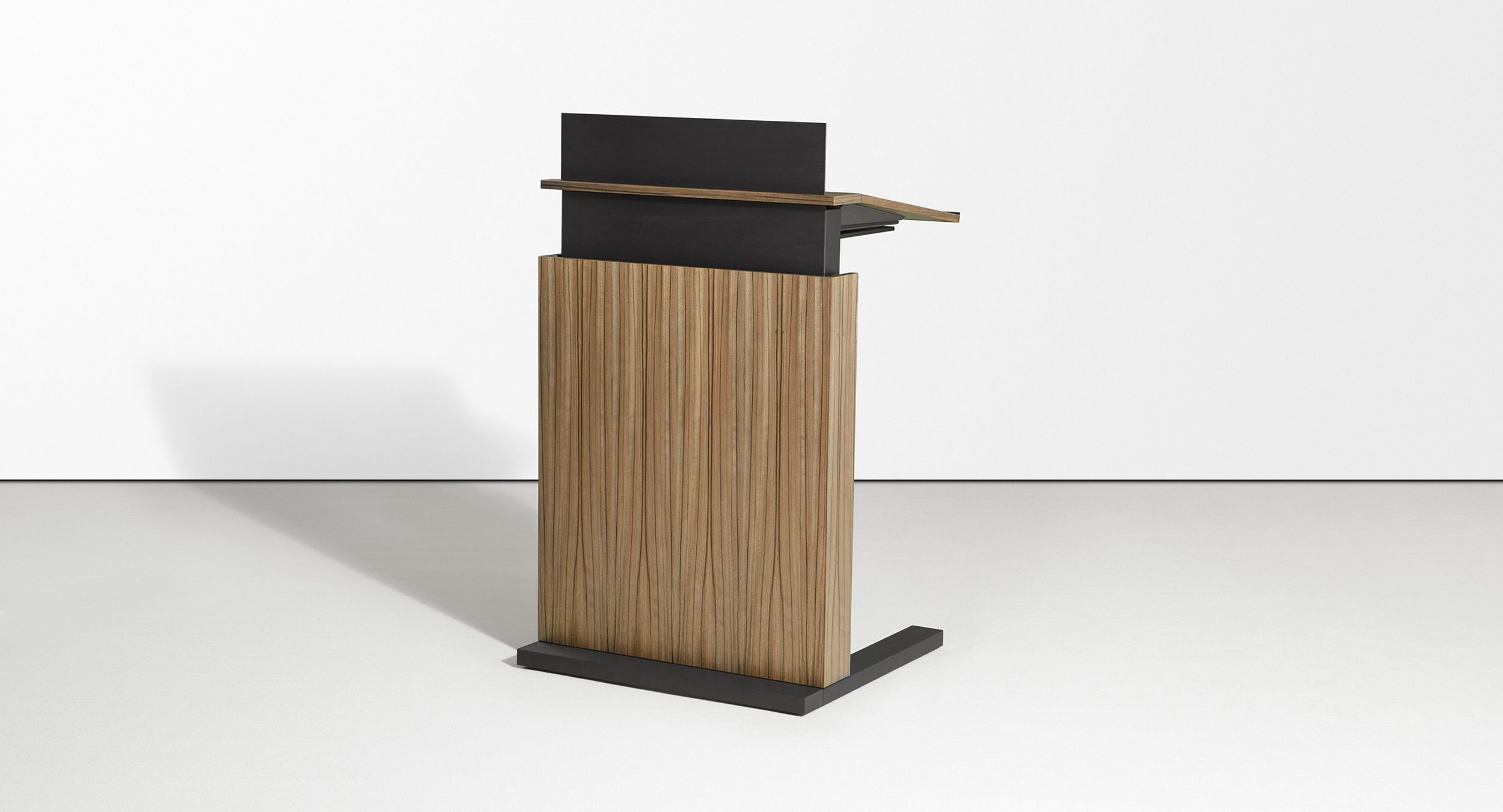 The Motus adjustable-height mobile lectern accommodates  presenters of every height with a push of a button.