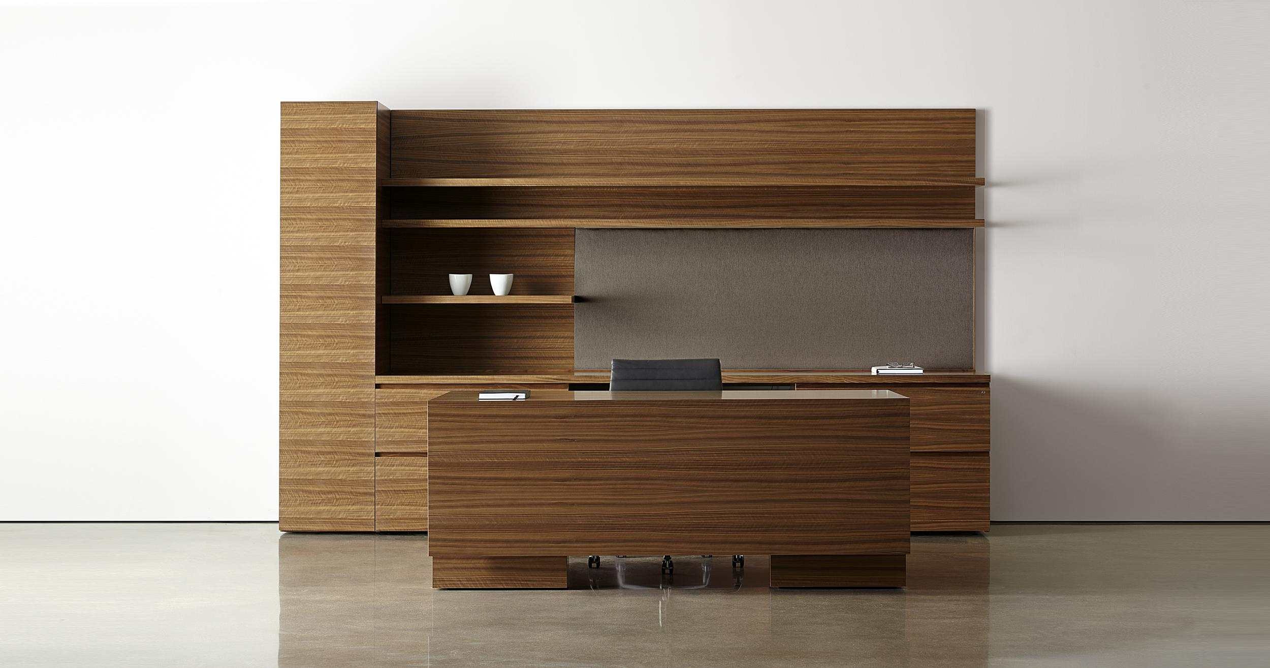 New Millennia features clean lines, perfectly matched veneers, and stunning adjustable-height desks.