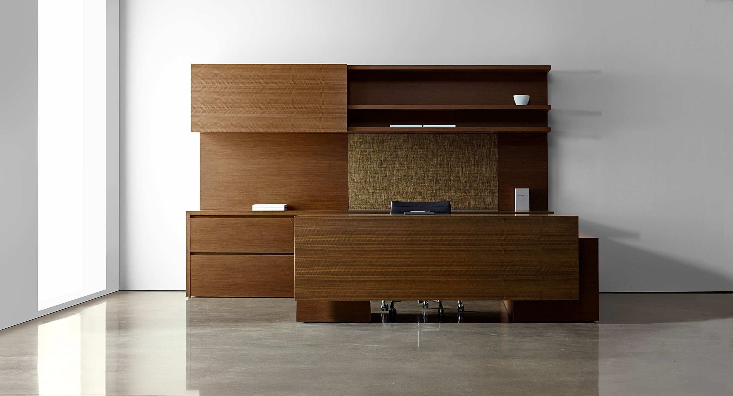 New Millennia cabinets feature smooth sliding doors and generous integral wood finger pulls.