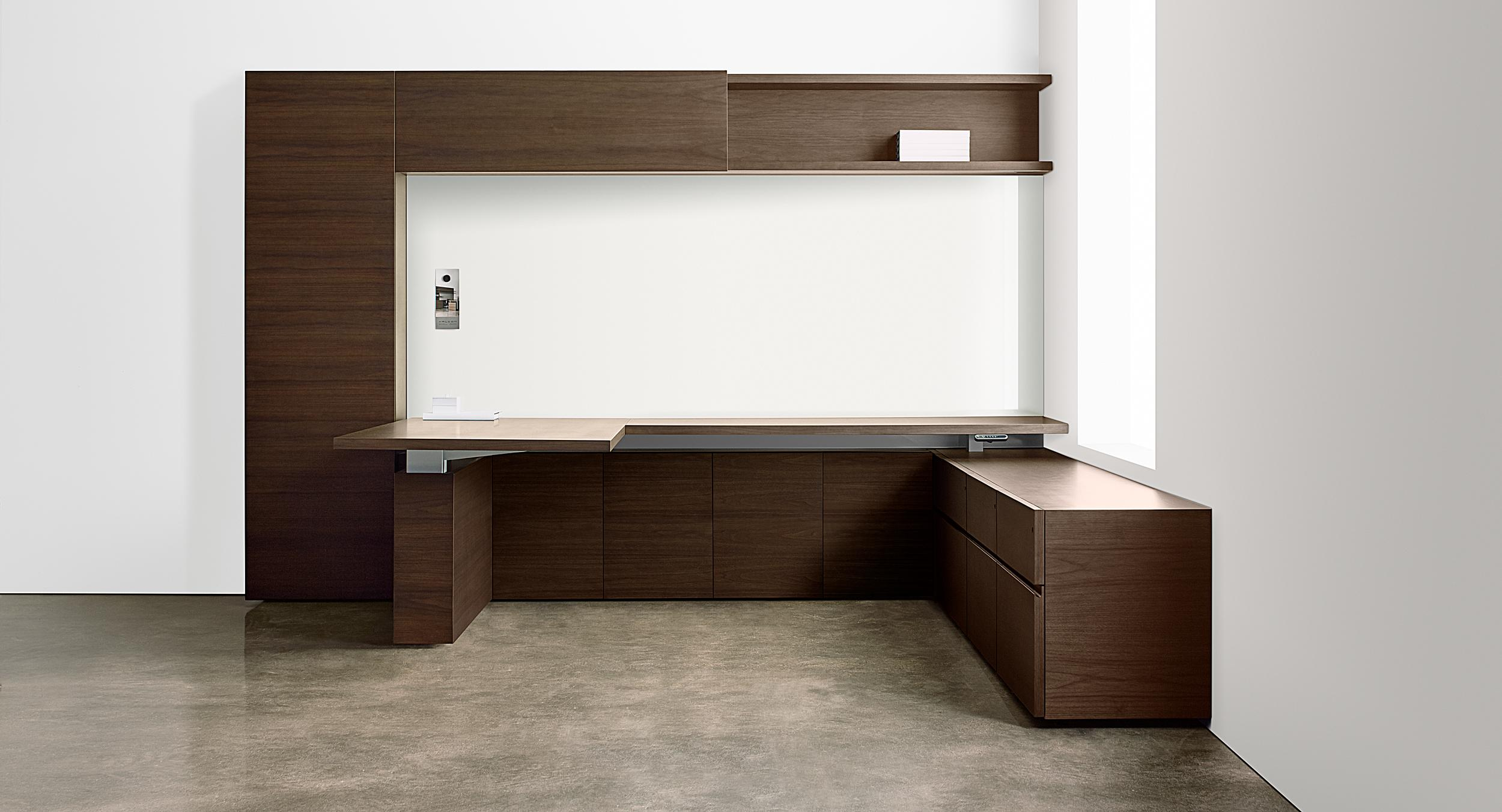 Adjustable-height desking seamlessly integrates into the timeless modern design.