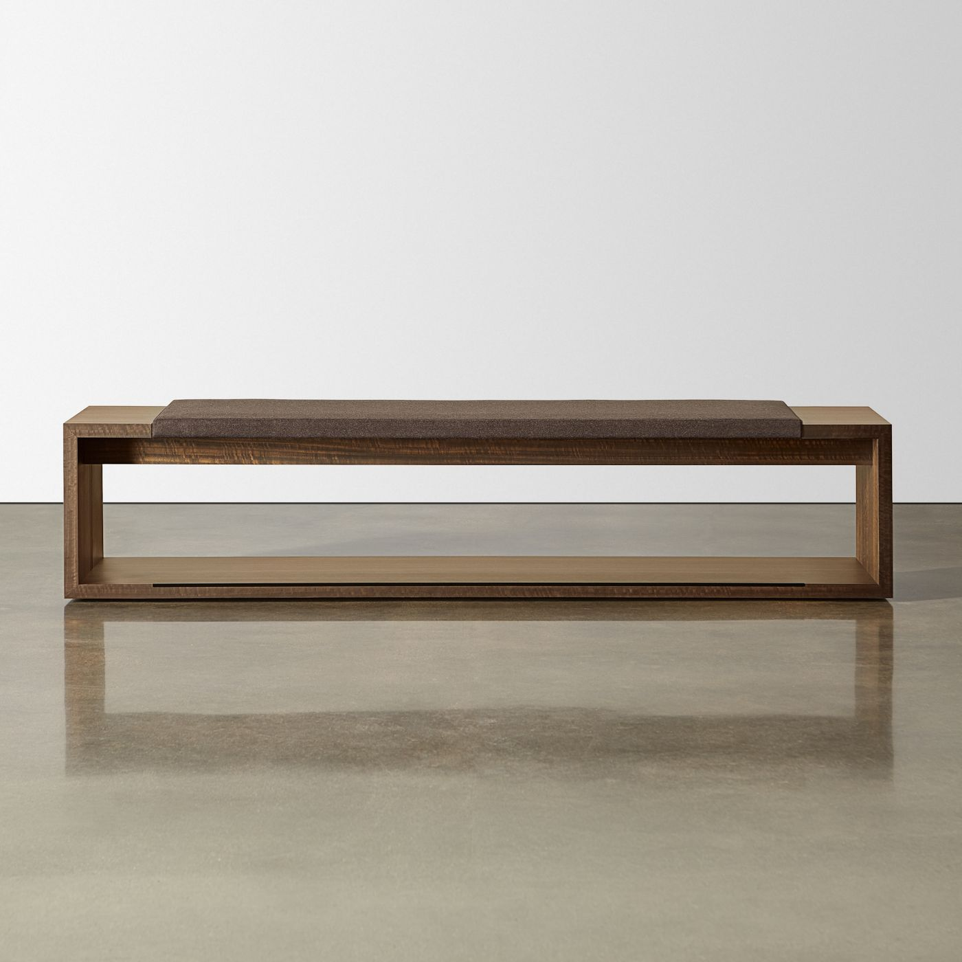 Each bench includes a gracious seating cushion and convenient end table surfaces.