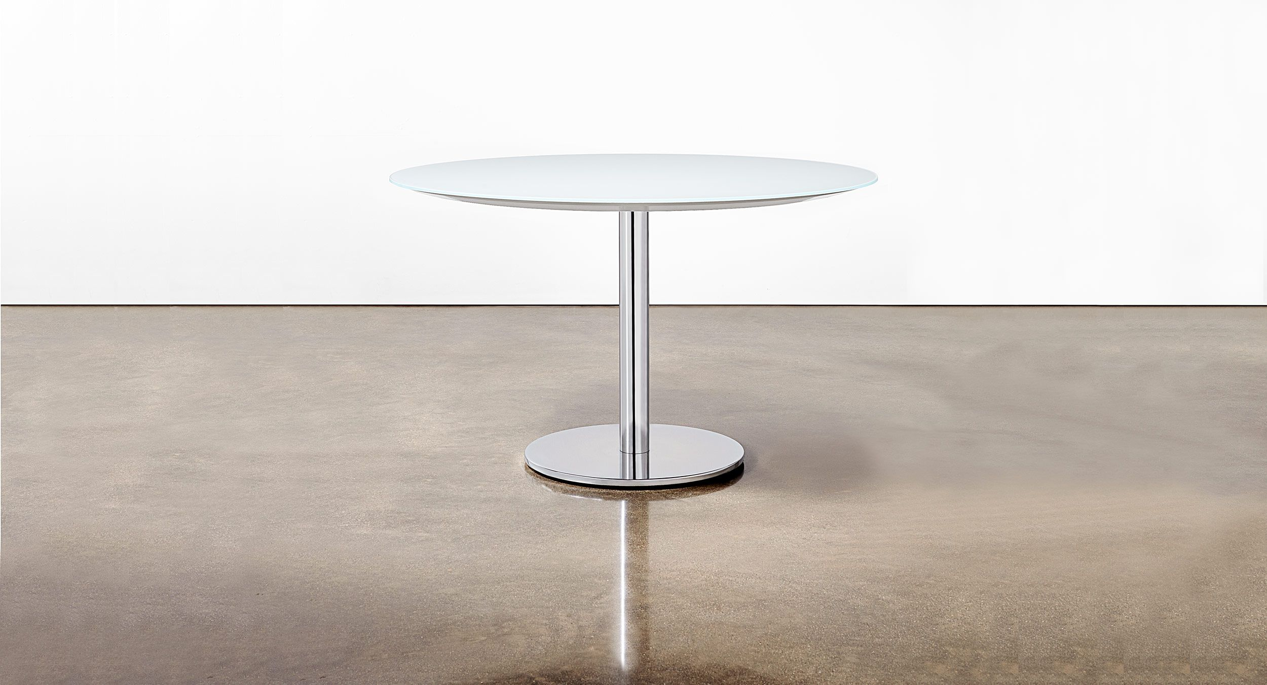 Glass table with Disc base