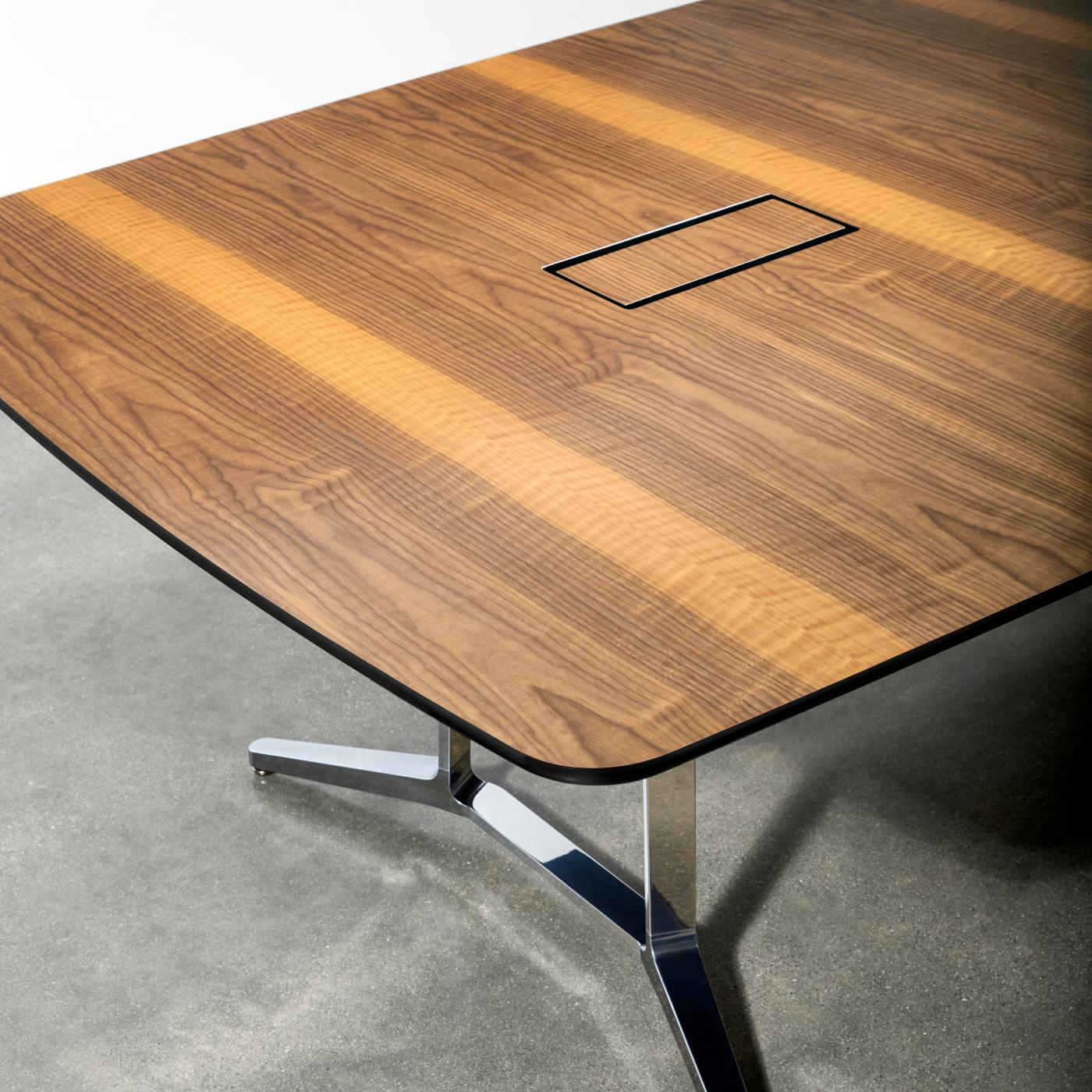 Power/data access doors are perfectly grain-matched to the table surface.