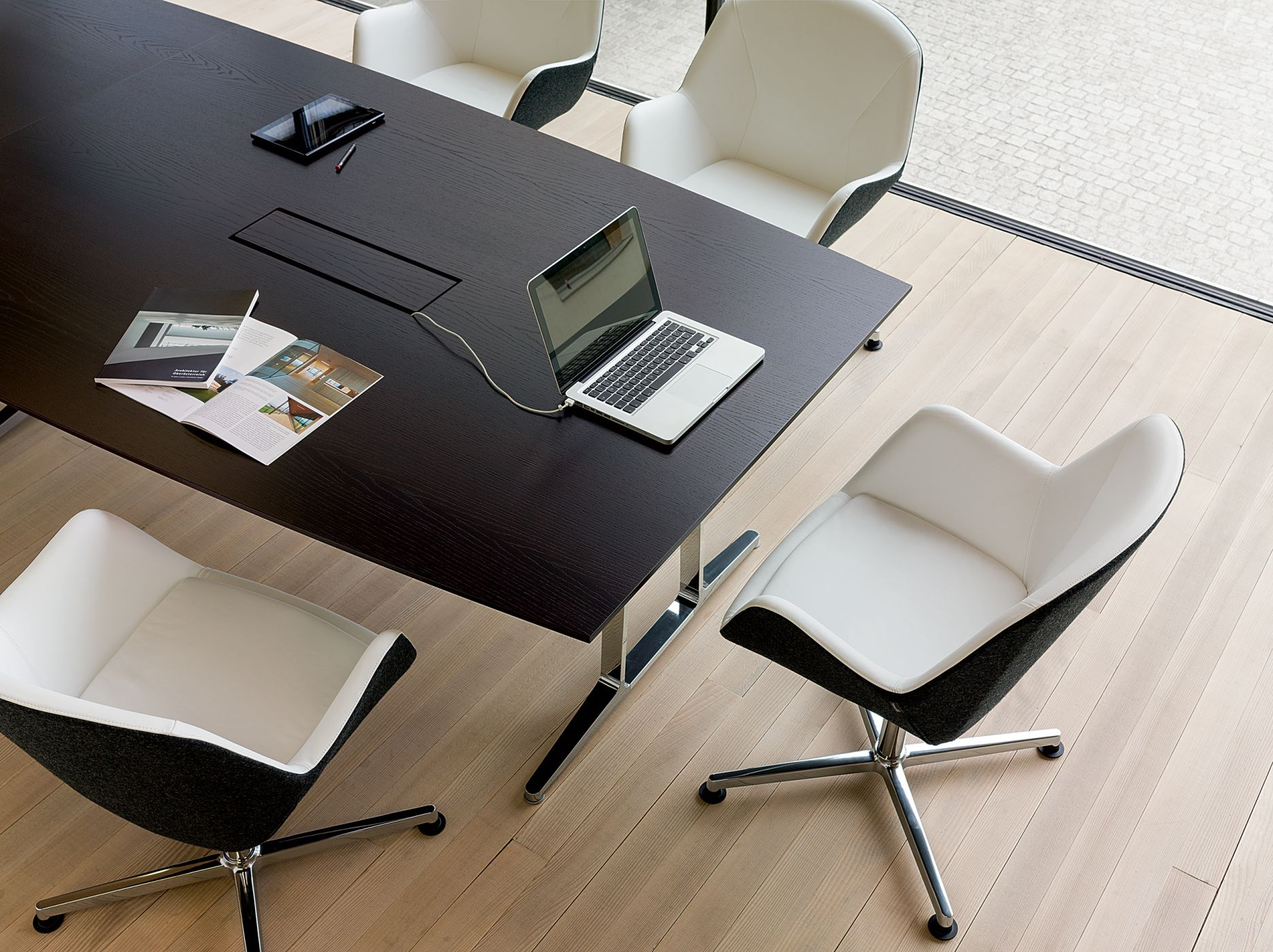 Conference tables feature signature dual-flipping power grommets.