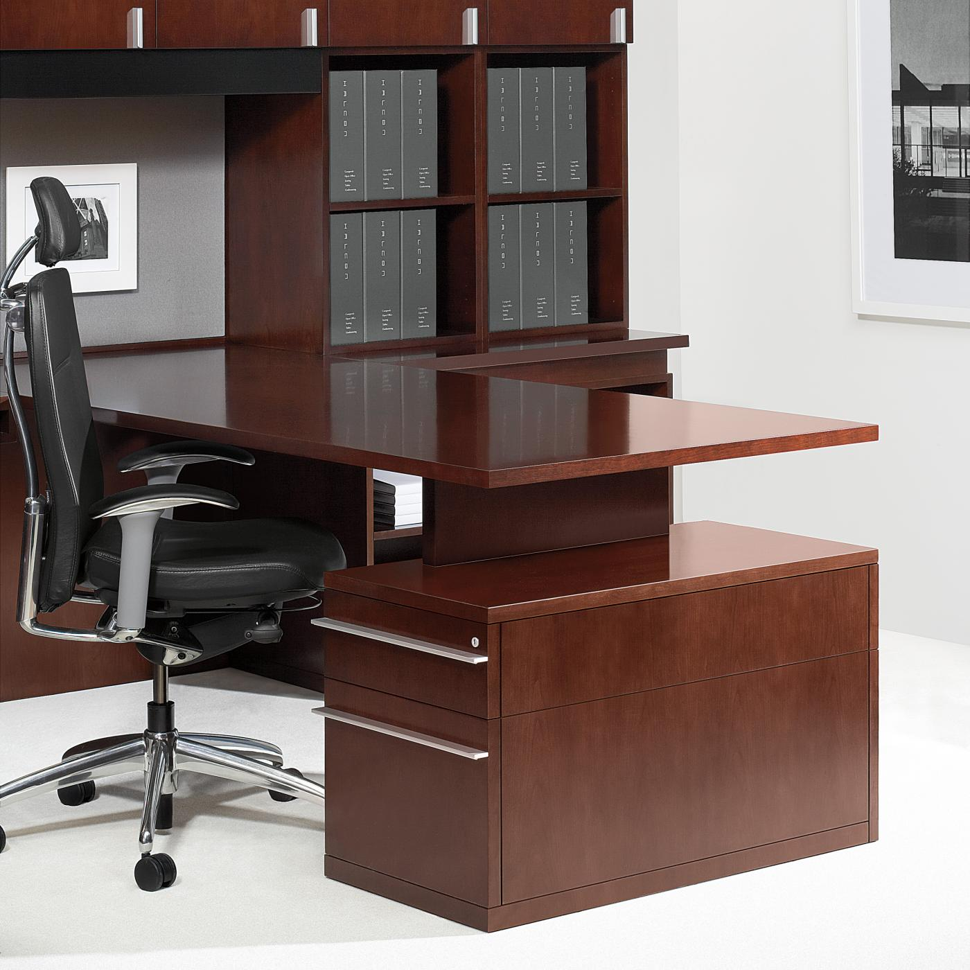 Desk worksurfaces float above casework, supported by a vertical fin.