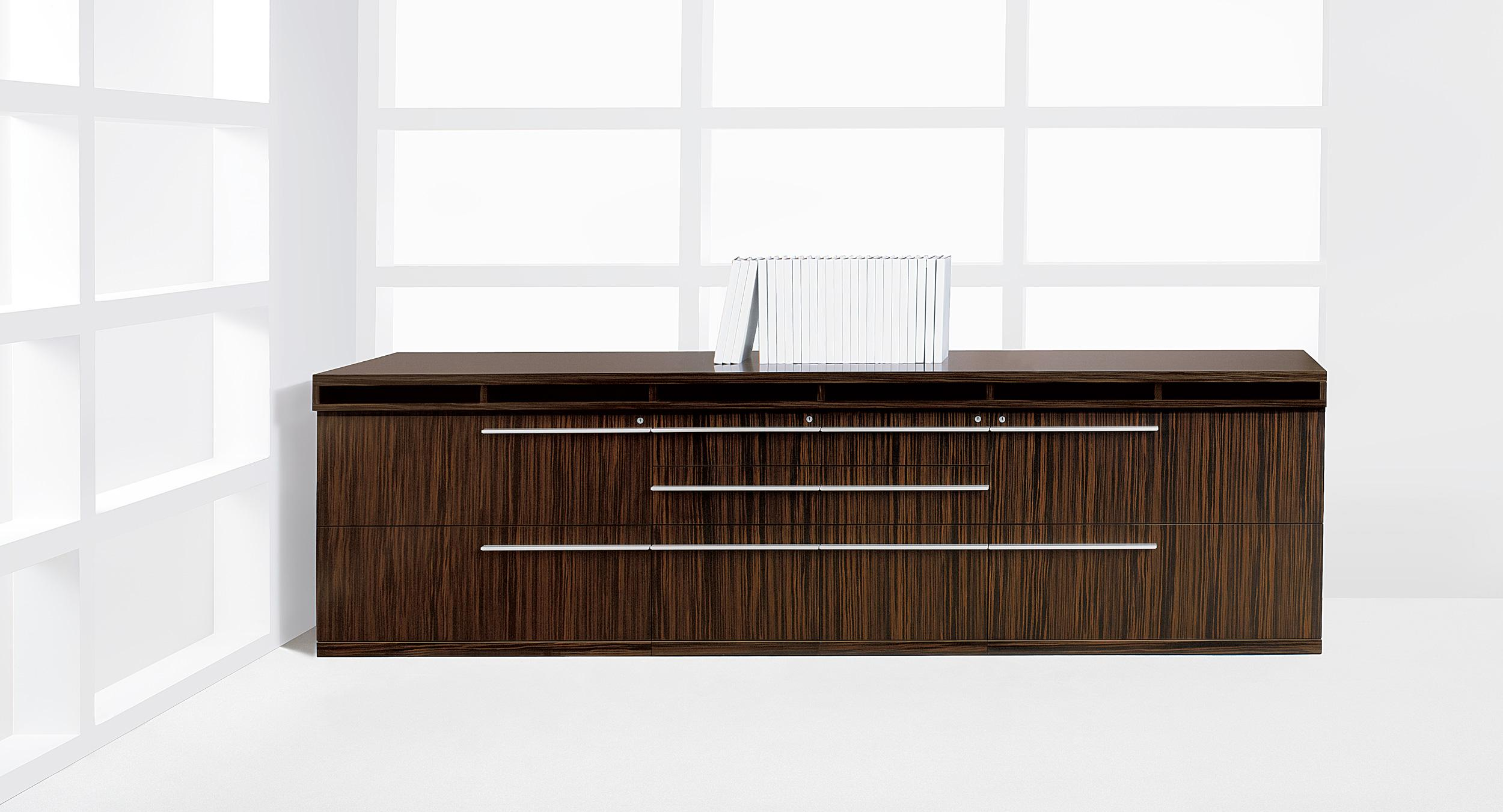Stria's linear satin aluminum pulls can be oriented to the left, right, or center of each drawer front.