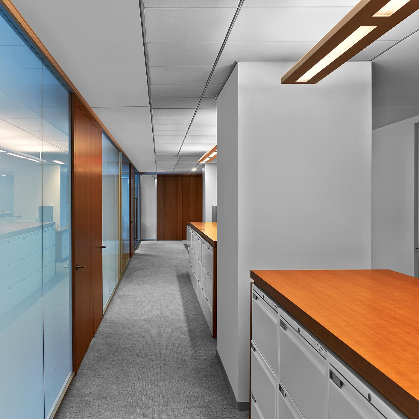 HALCON provided filing cabinets with anigre wood surrounds.