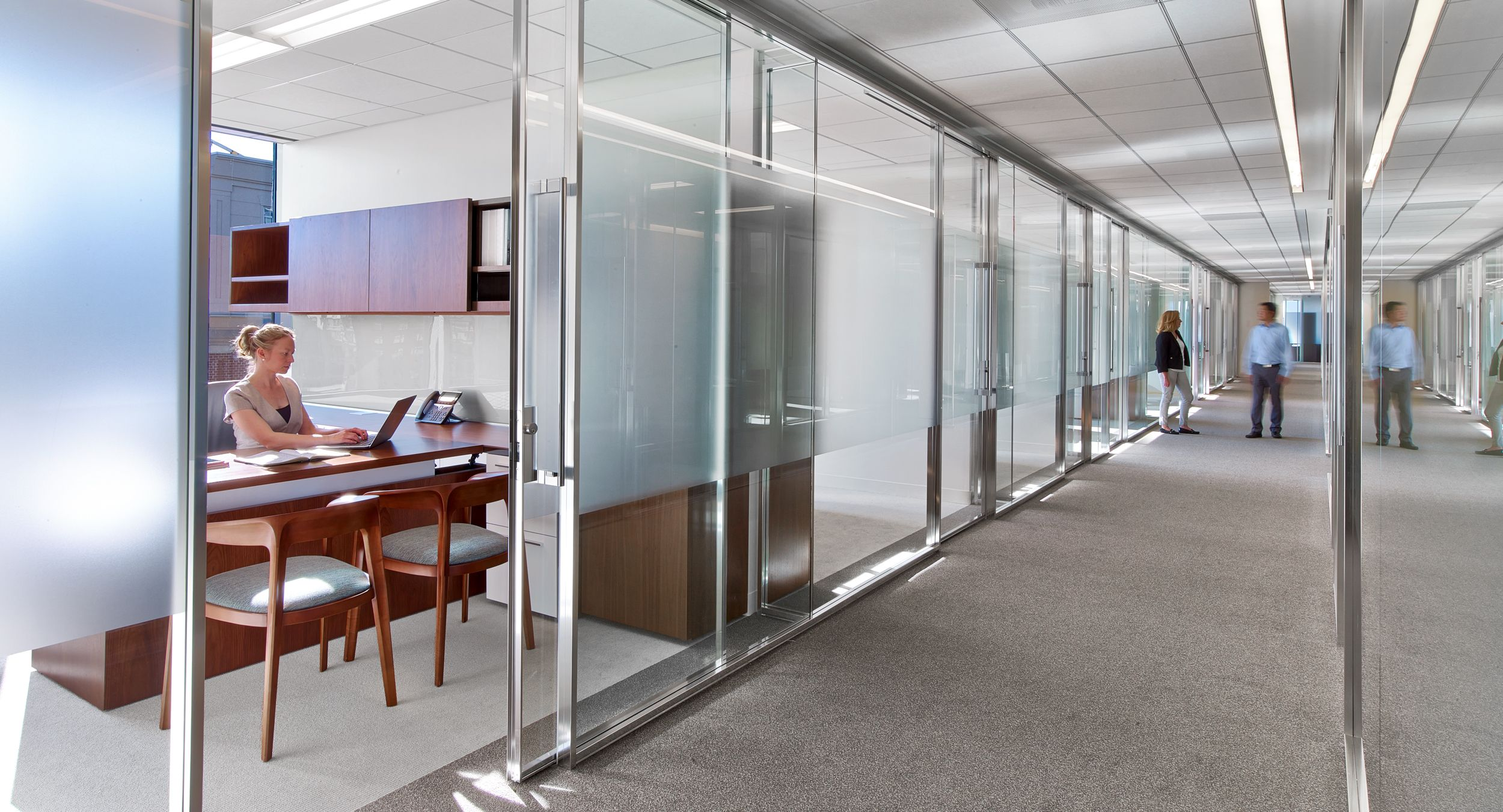 Associate offices feature integrated adjustable-height desking.