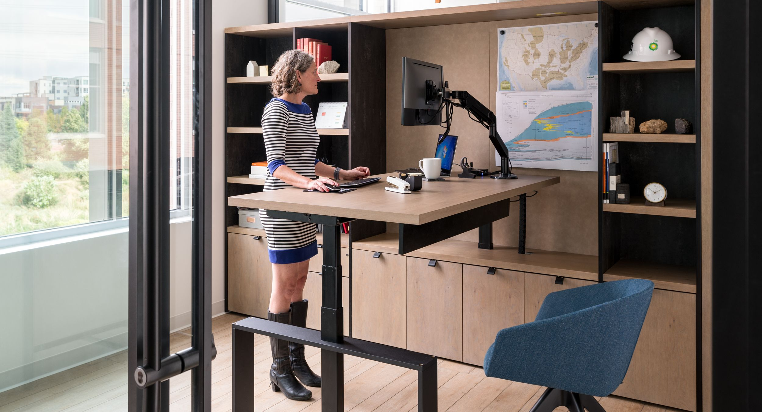 Custom private offices feature adjustable-height desking and integrated workwall storage.