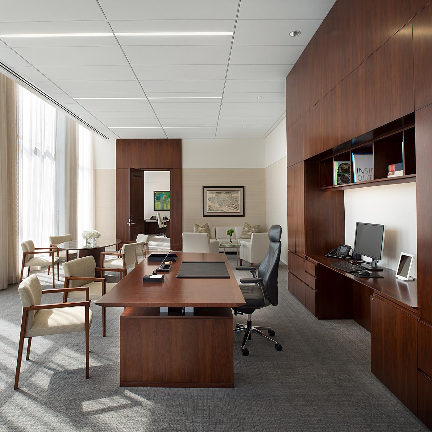 Adjustable-height desks were custom-designed to meet the aesthetic and functional needs of the project.