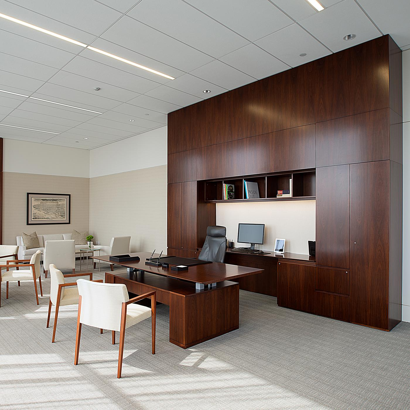A 12-foot high workwall with perfectly sequence-matched walnut highlights the CEO office.