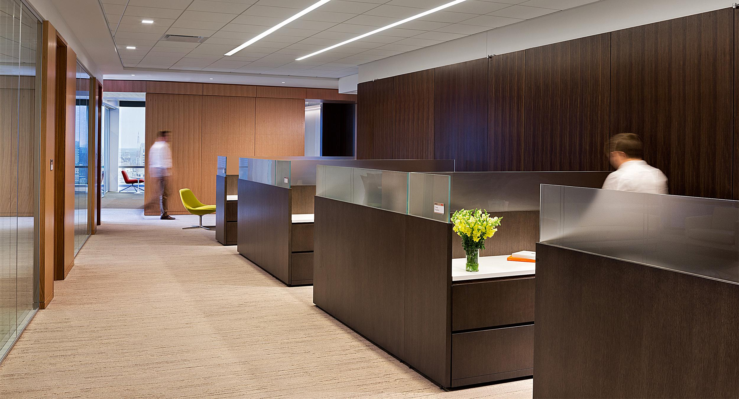 Rift cut veneers and etched glass create sophisticated administrative workstations.
