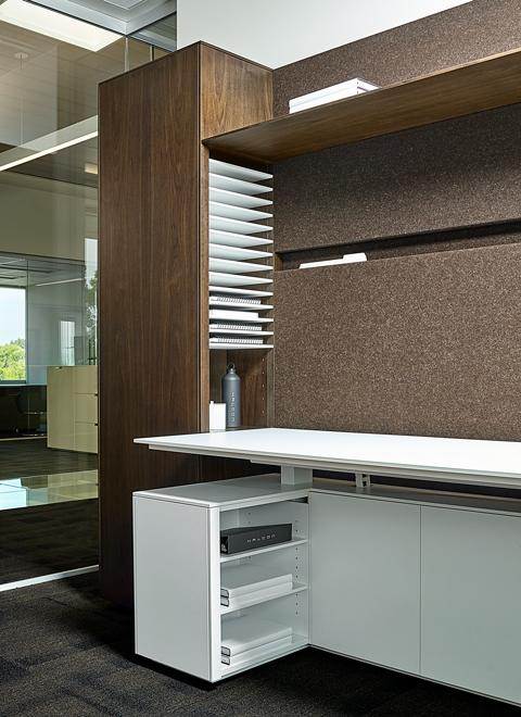 Project Manager offices were designed for quick access to active files.  This open storage faces toward the user, but is concealed from the hallway.   Innovative wall file slots were developed to cleanly provide additional active file storage.