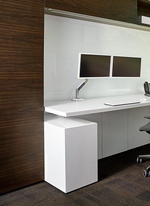 Adjustable-height worksurface are provided throughout the space.