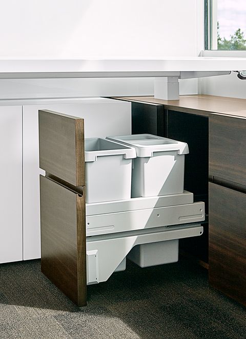 All waste bins, CPUs, and even a few refrigerators  are cleanly integrated into the furniture solution throughout the office.