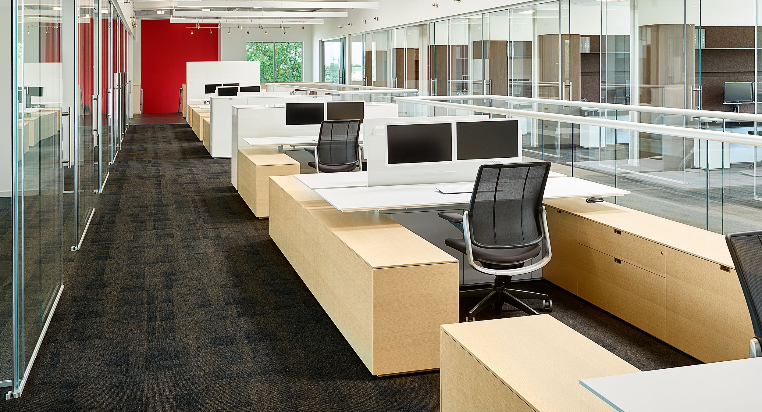 Adjustable-height desking, high gloss acrylic screens, and sleek low storage highlight our sales support workstations.