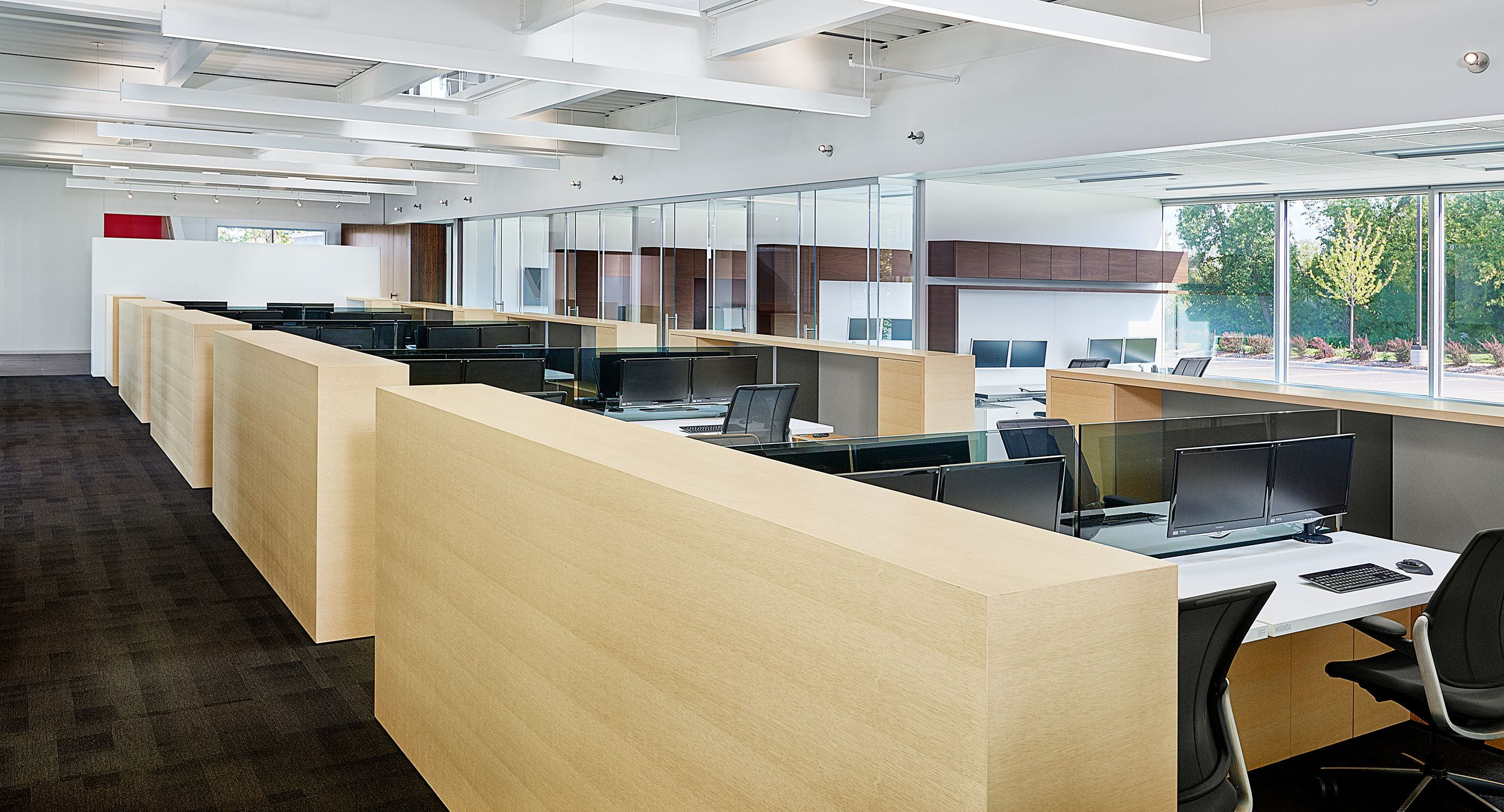 Adjustable-height desking, tinted glass screens, and seamless cabinetry highlight our engineering workstations.
