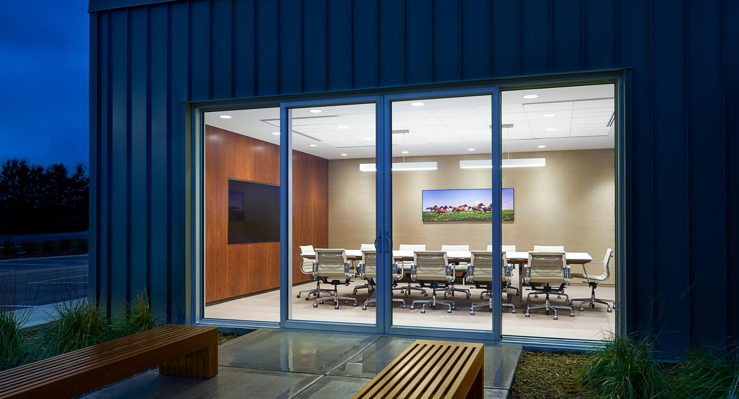 Our main conference room features a MESA table with a custom integrated media wall in Figured Walnut.