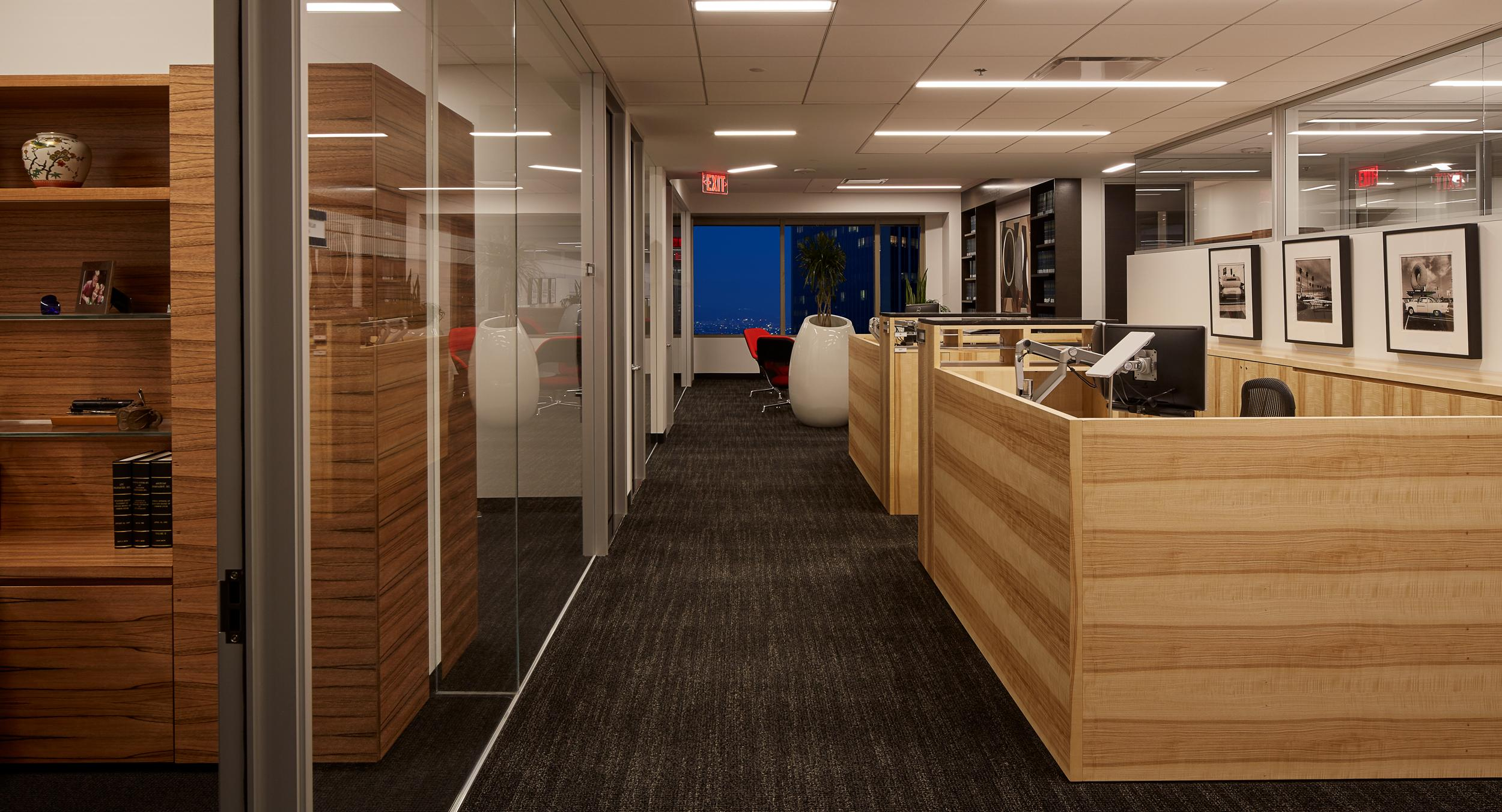 Private and open office furniture showcases beautifully-matched Paldao and Olive Ash veneers.