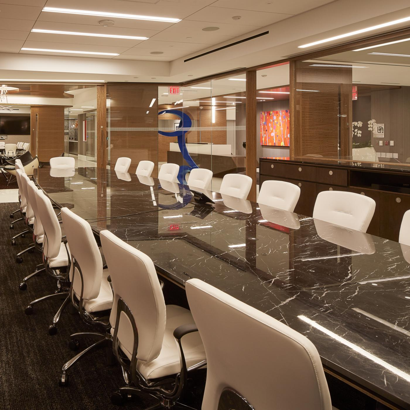 Mesa tables of varied shapes and sizes are utilized throughout the conference space.