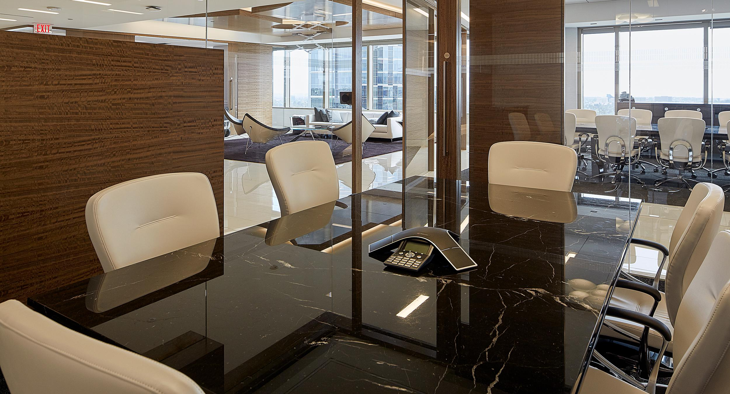 Hogan's conference rooms feature Mesa tables with beautiful polished stone surfaces.