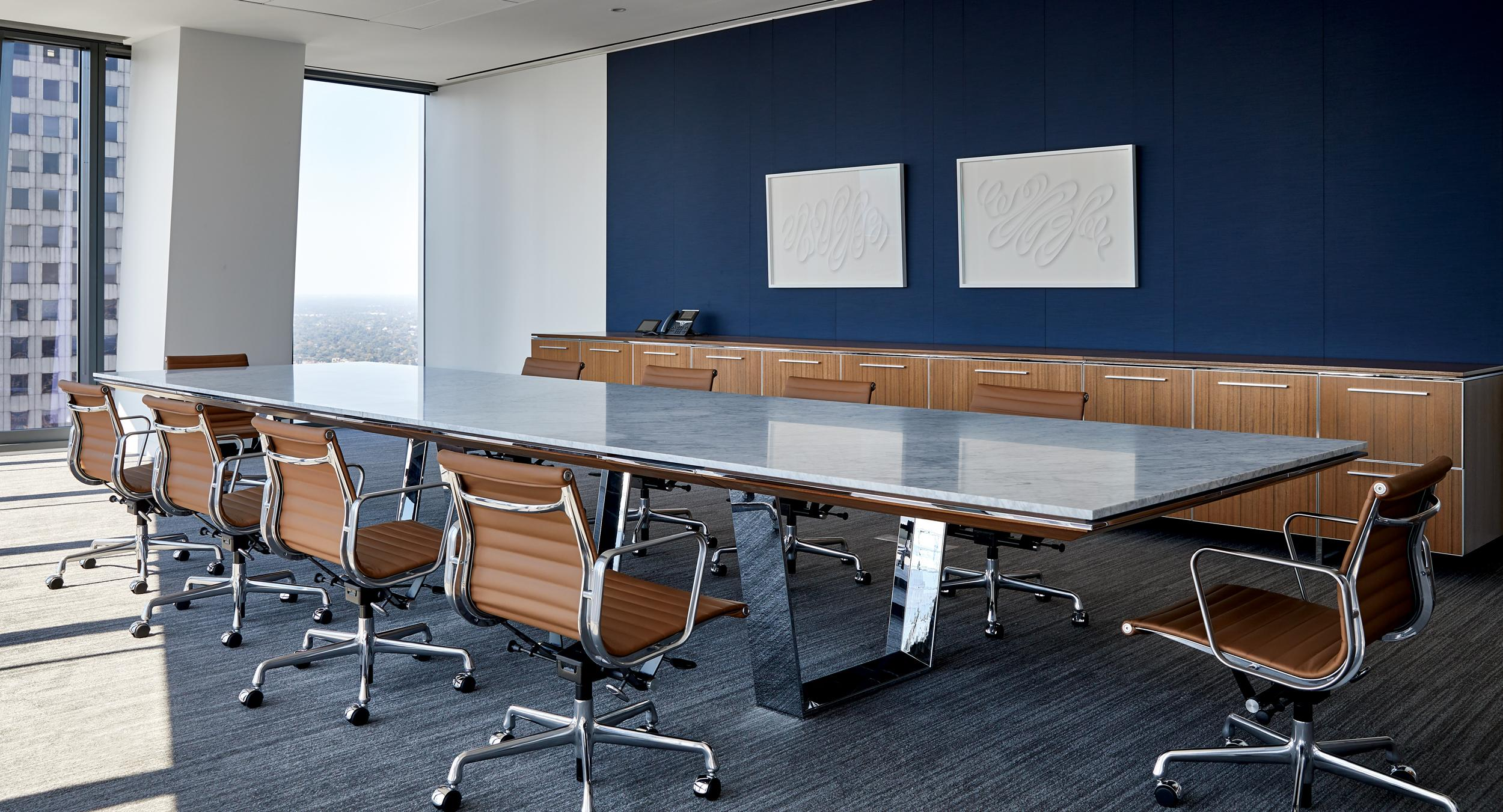 A stunning MESA conference table with storage credenza in Quarter Cut Paldao.
