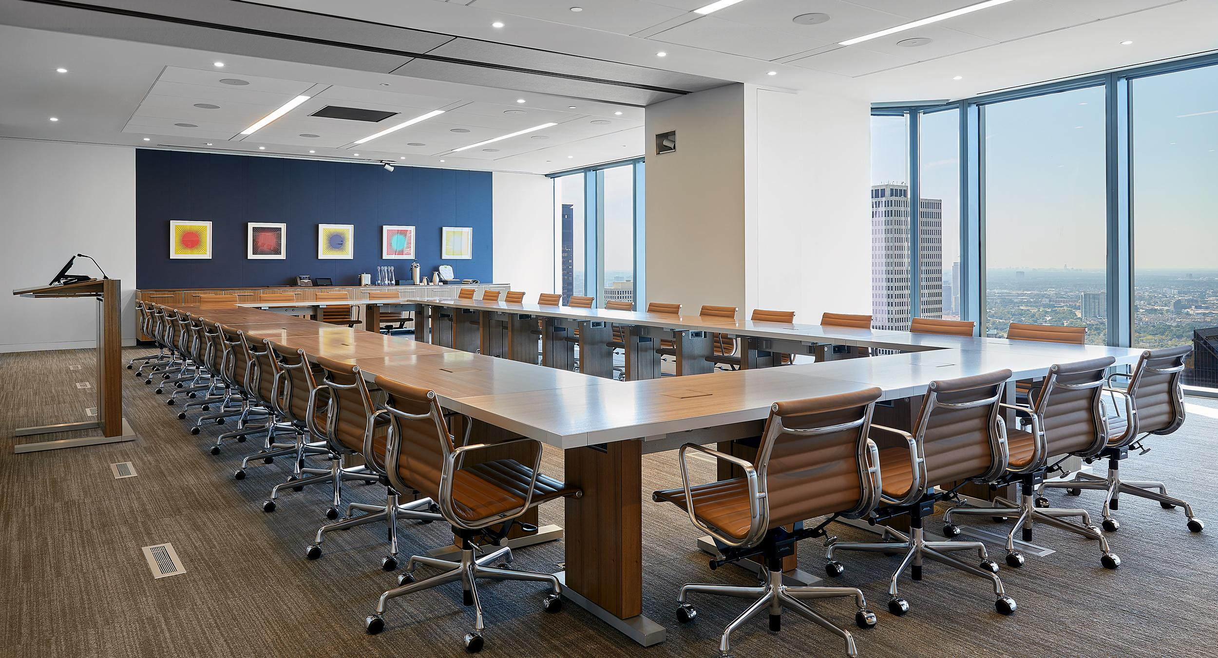 MOTUS tables in Paldao and Brushed Aluminum result in an executive meeting room that is as beautiful as it is functional.