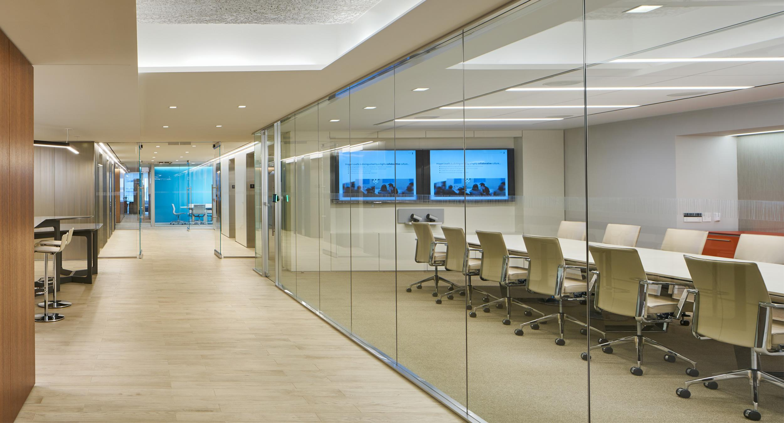 Hogan's conference center features MESA tables and custom-tailored storage credenzas.