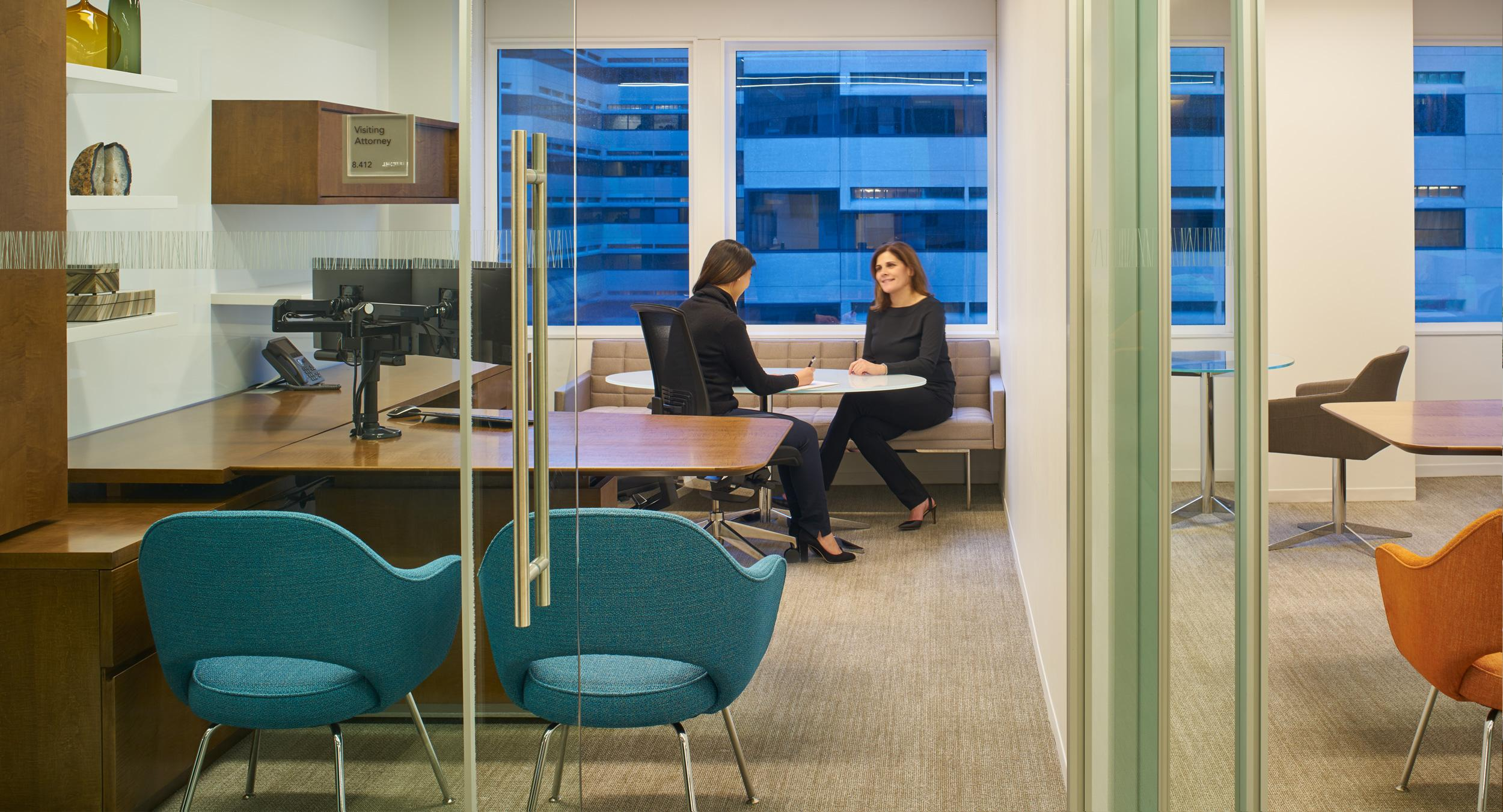 Universal attorney offices feature adjustable-height desking and a comfortable meeting space.