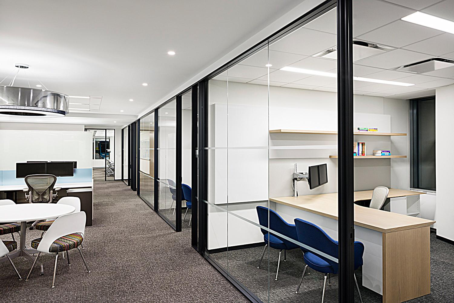 Our client's unique vision and exacting specifications resulted in fully customized private offices and open plan benching.