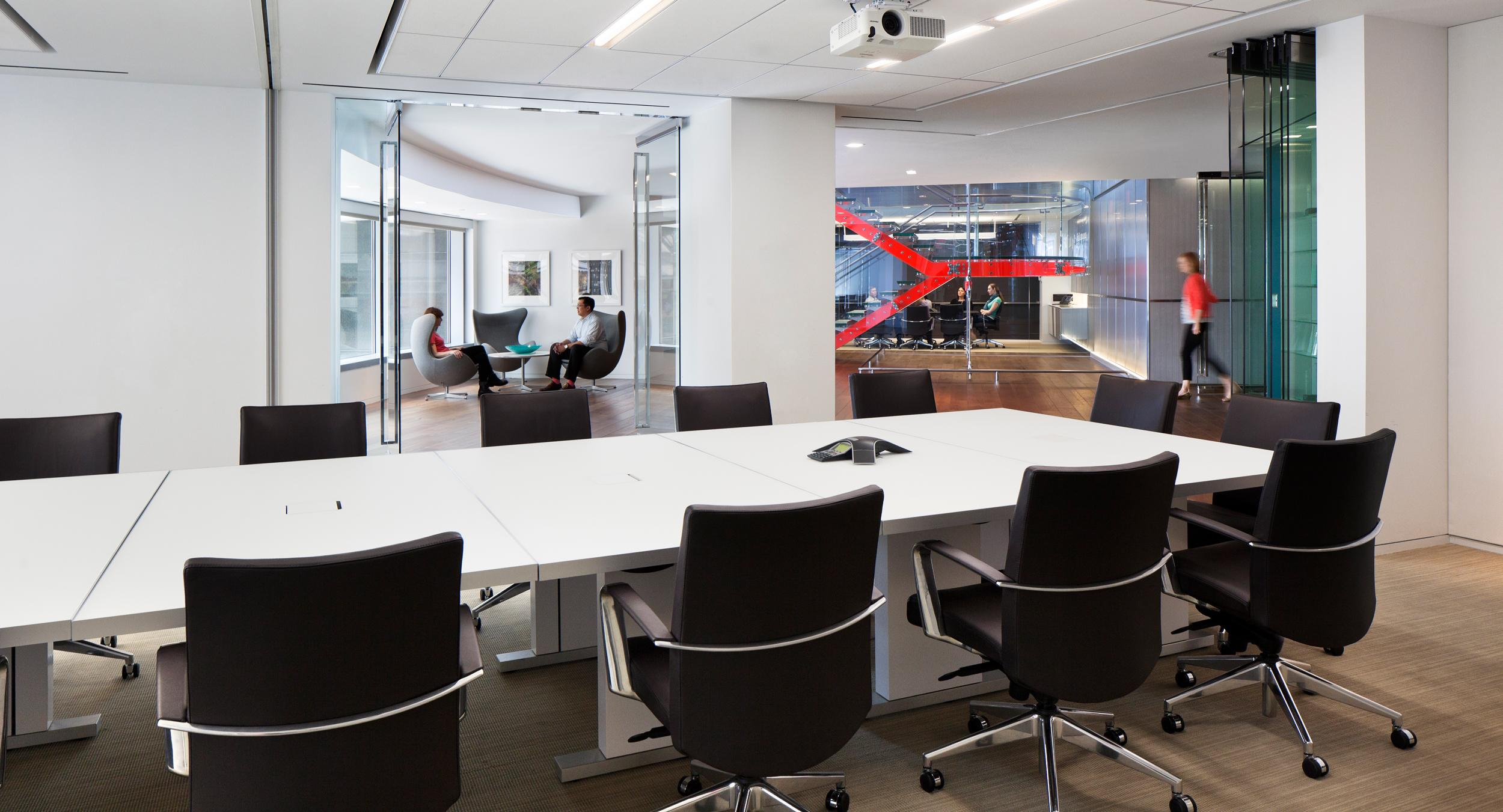 MOTUS tables in etched white glass create conference space that is beautiful and flexible.