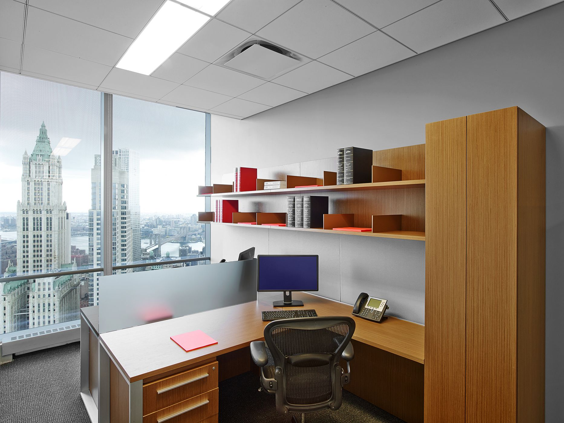 A double associate configuration includes an acrylic panel to divide shared space.