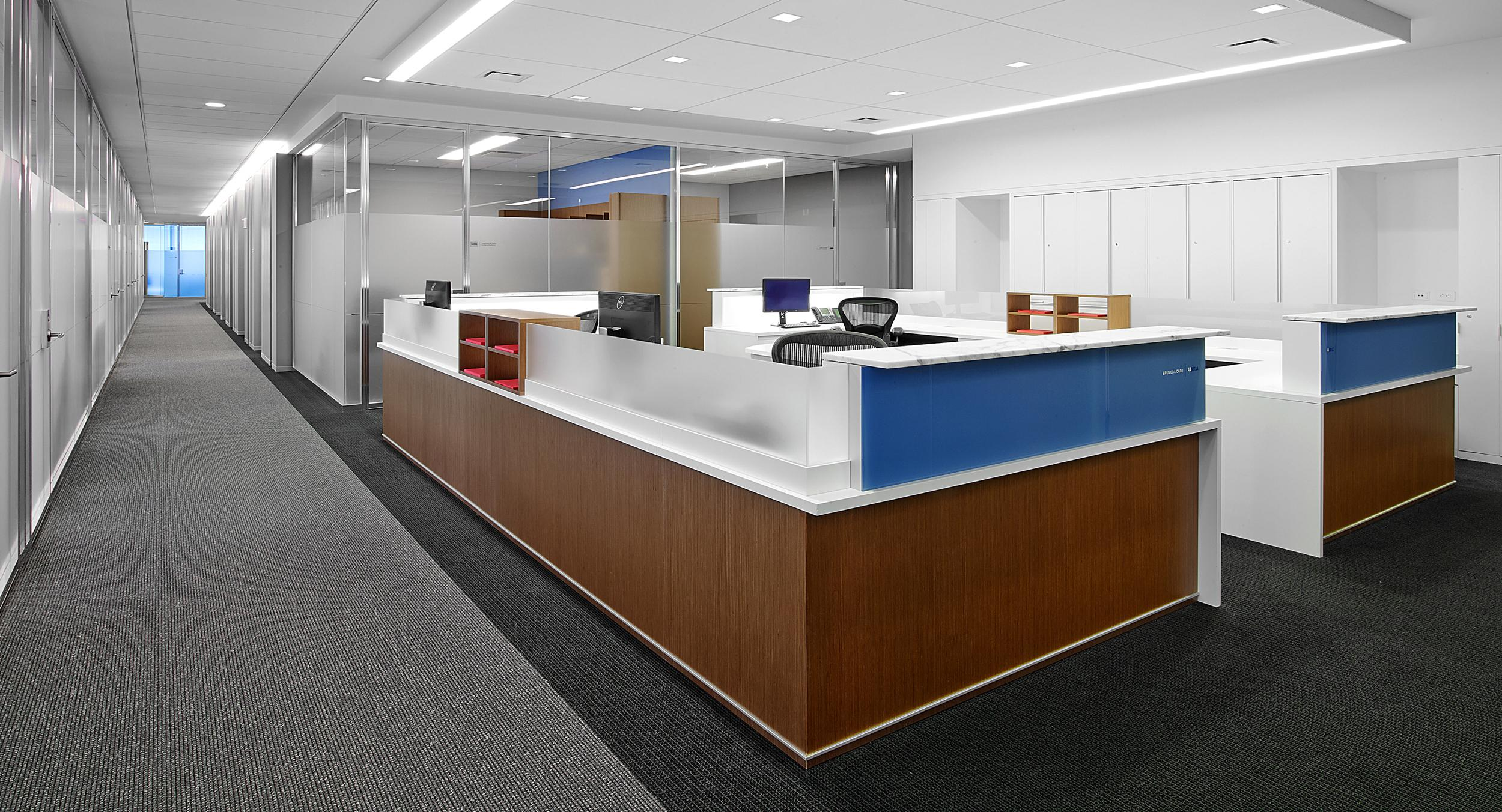 Administrative stations integrate a wide variety of materials:  Stone, tinted glass, acrylic, veneer, laminate, and satin aluminum.