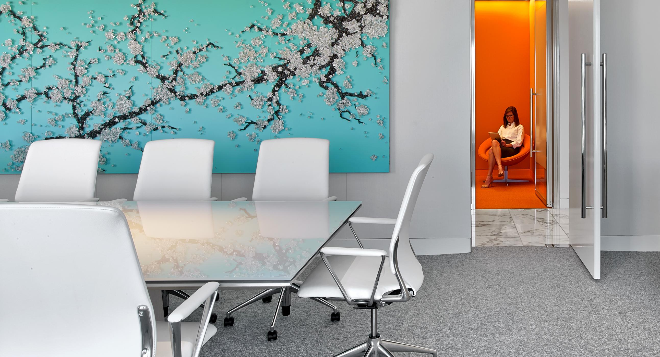 Glass MESA tables provide a beautiful, clean meeting surface for this colorful office.